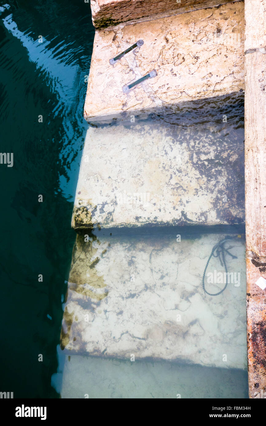 Stairs leading into water - Stock Image