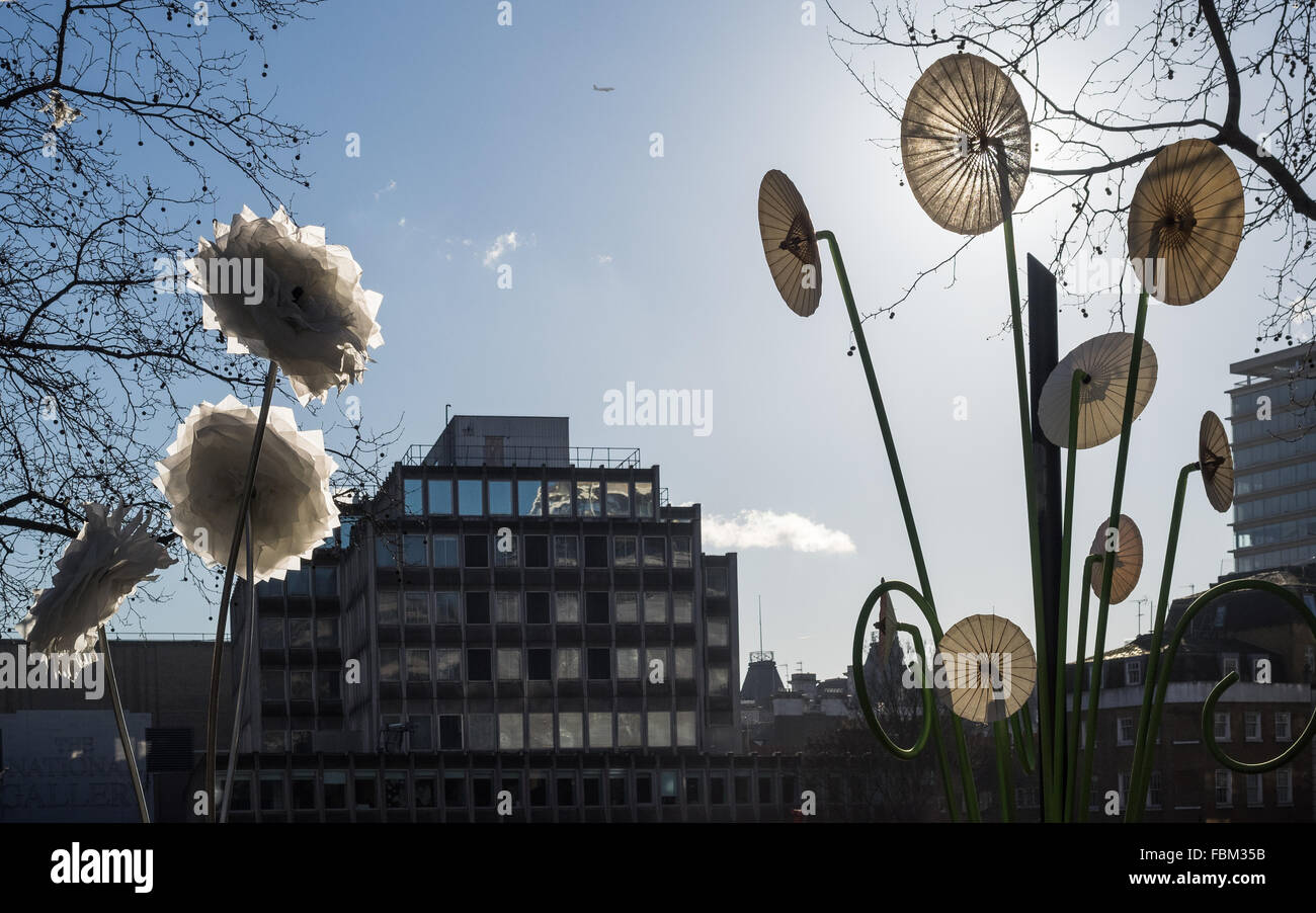 a London Lumiere flower exhibit by day with clear blue sky into the sun in silhouette in Leicester Square UK - Stock Image