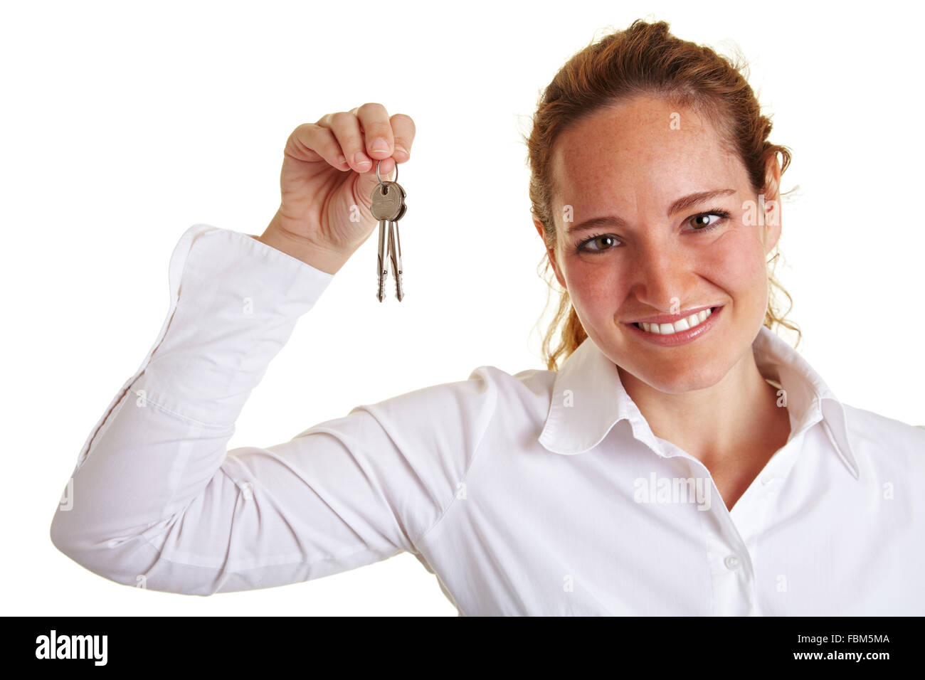 Happy business woman showing two keys in her hand - Stock Image