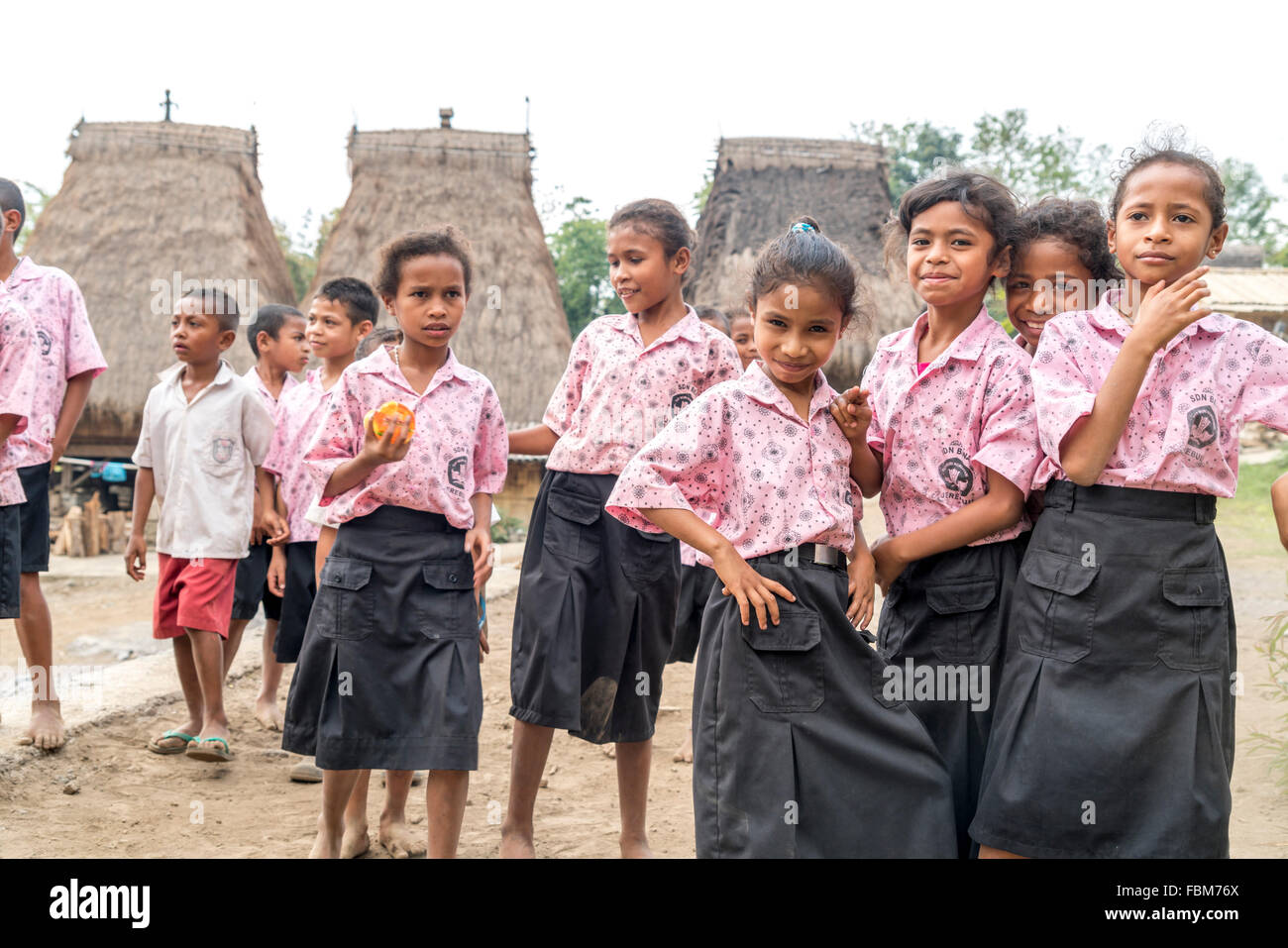 school children in uniform in the traditional Ngada village Bena near Bajawa, Flores, Indonesia, Asia - Stock Image