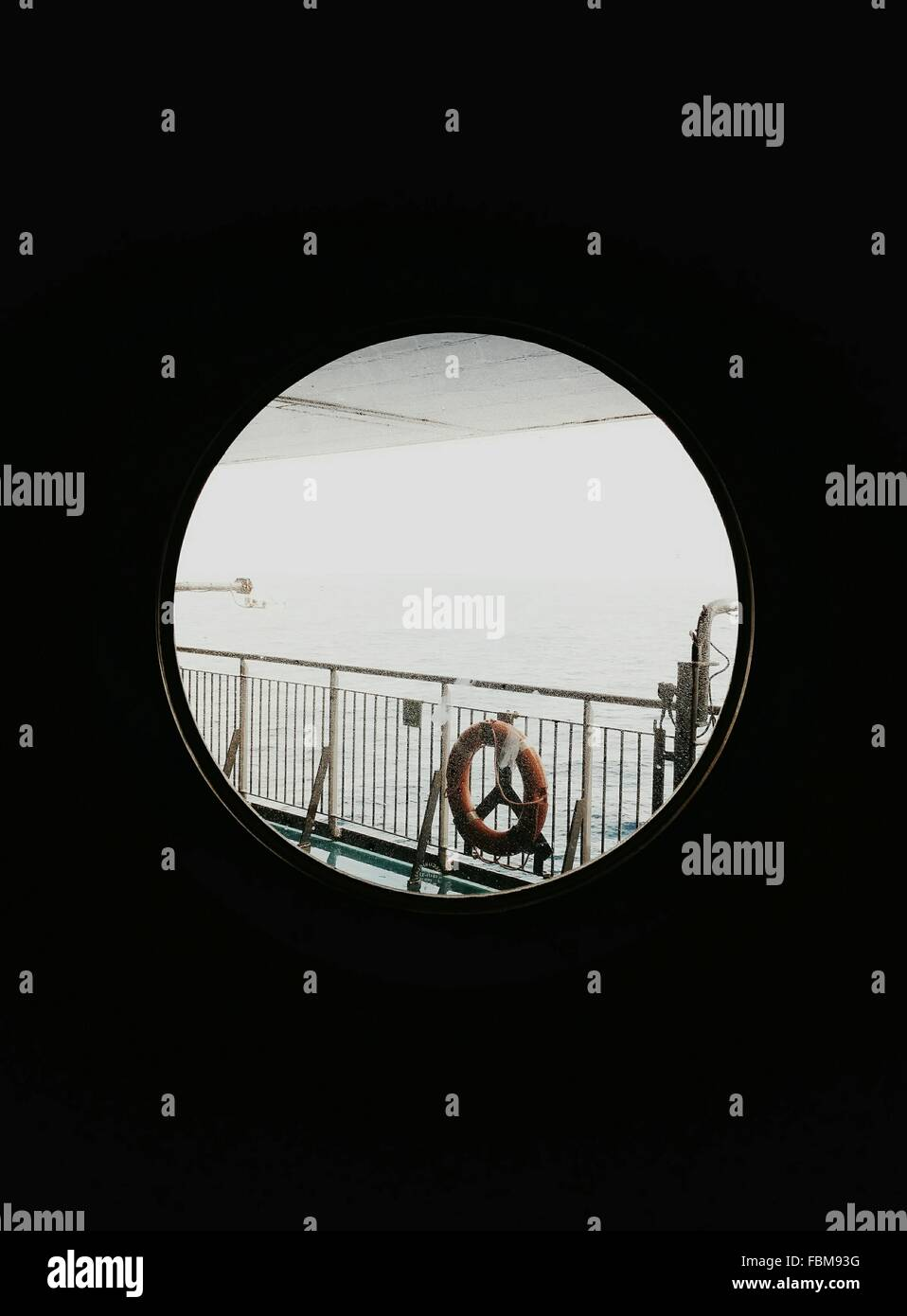 View Of Safety Ring On Railing Though Round Window - Stock Image