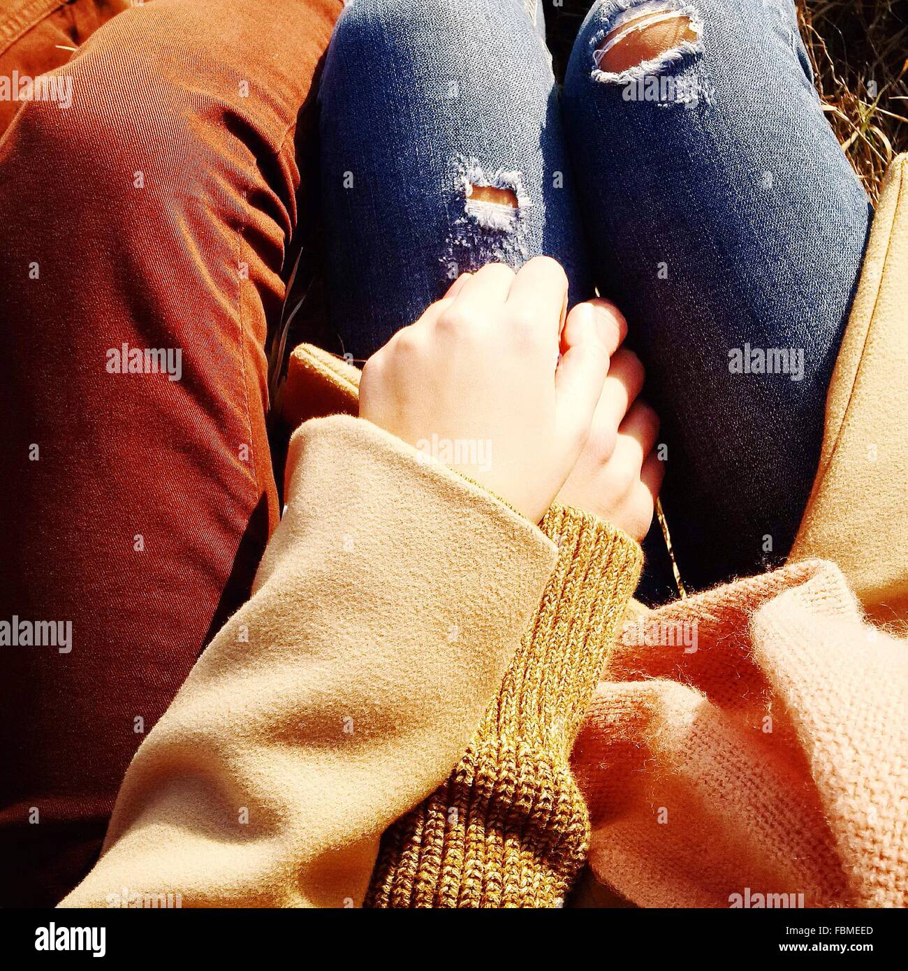 Close-up of a Couple holding hands - Stock Image