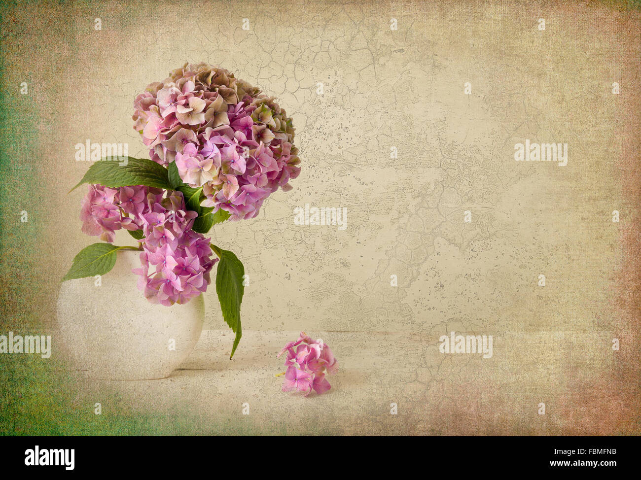 Painterly textured flower still life on old wooden board - Stock Image