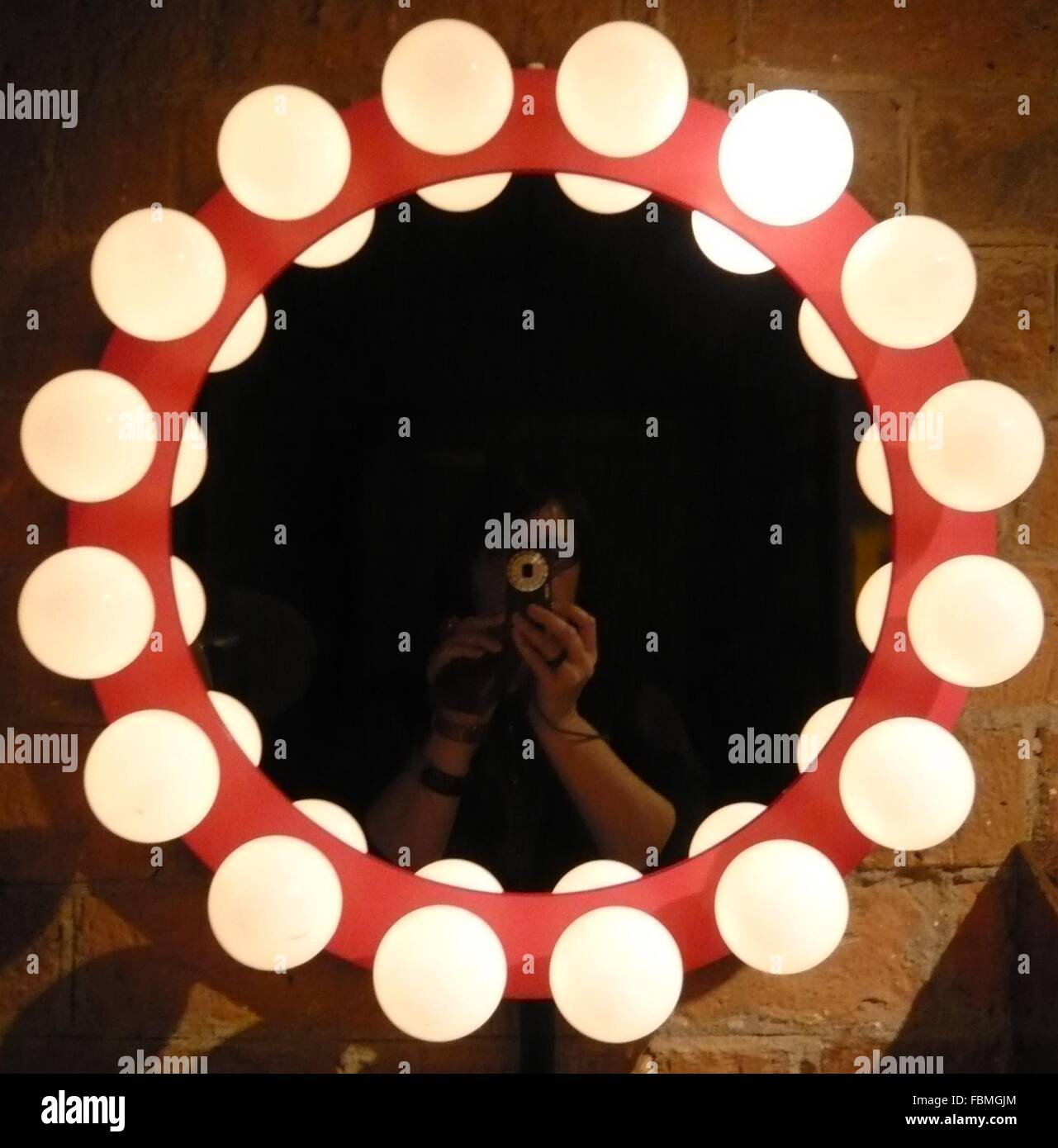 Woman Shooting Circular Illumination Device - Stock Image