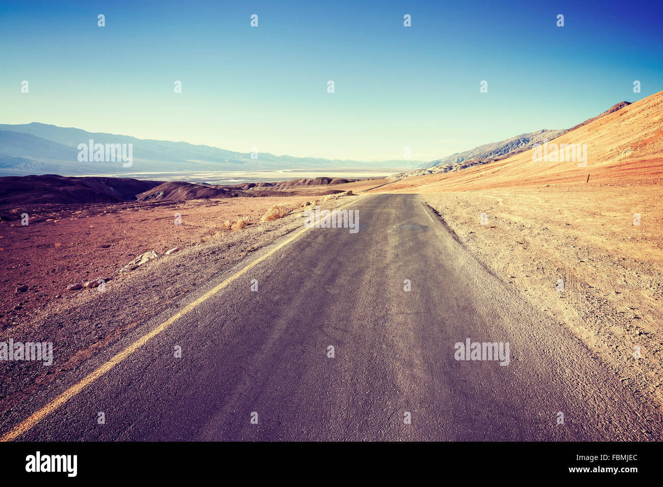 Vintage filtered empty desert road. Stock Photo