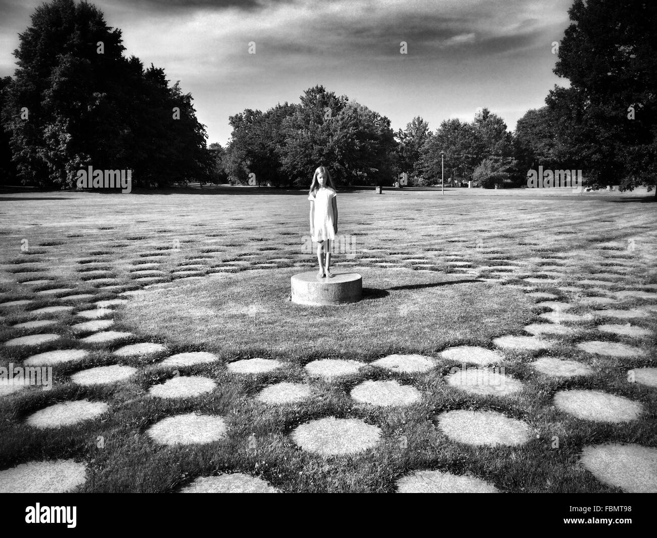 Full Length Of Woman Standing In Park - Stock Image