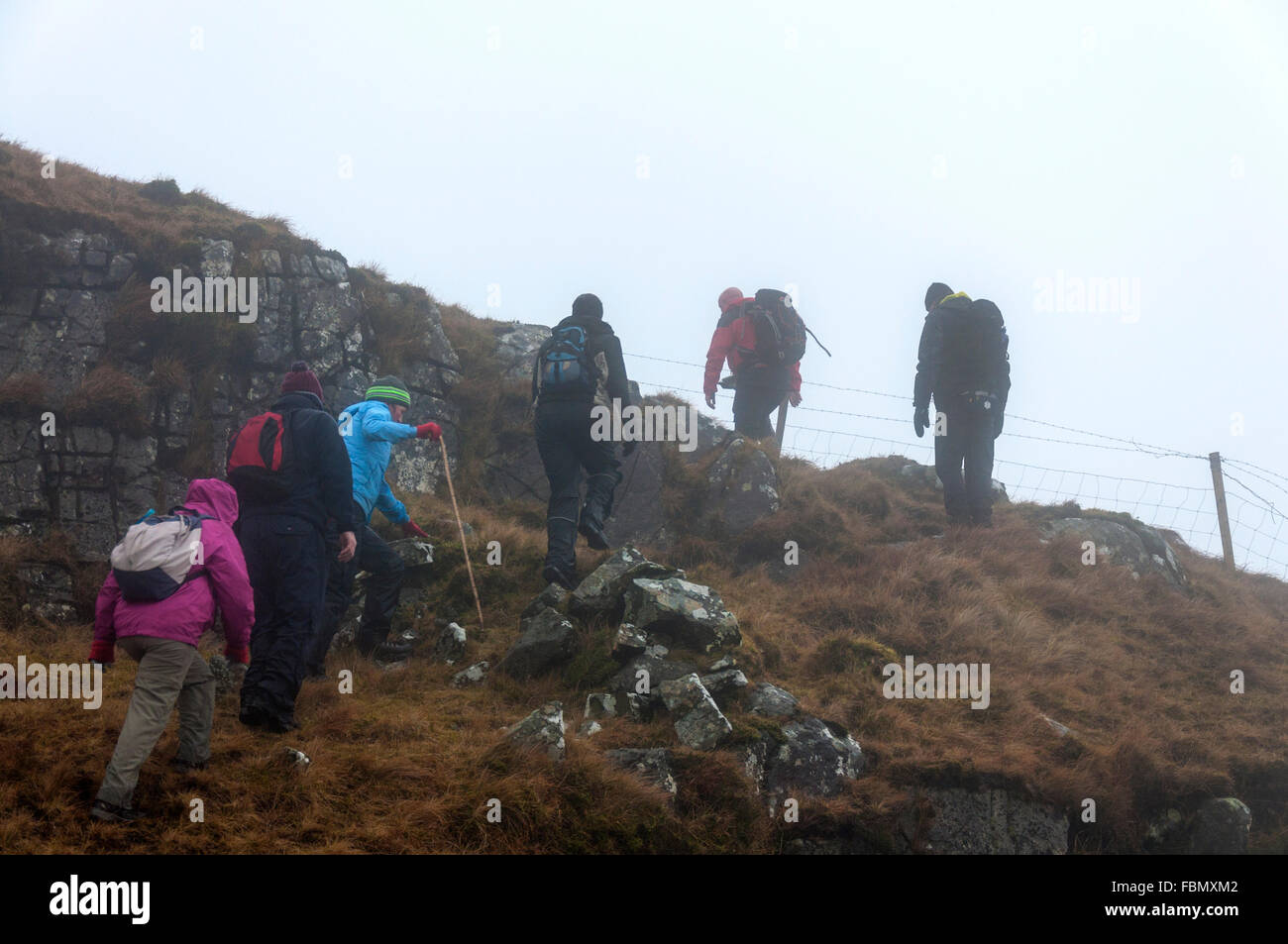 Walkers in mist on Common Mountain above Ardara, County Donegal, Ireland - Stock Image