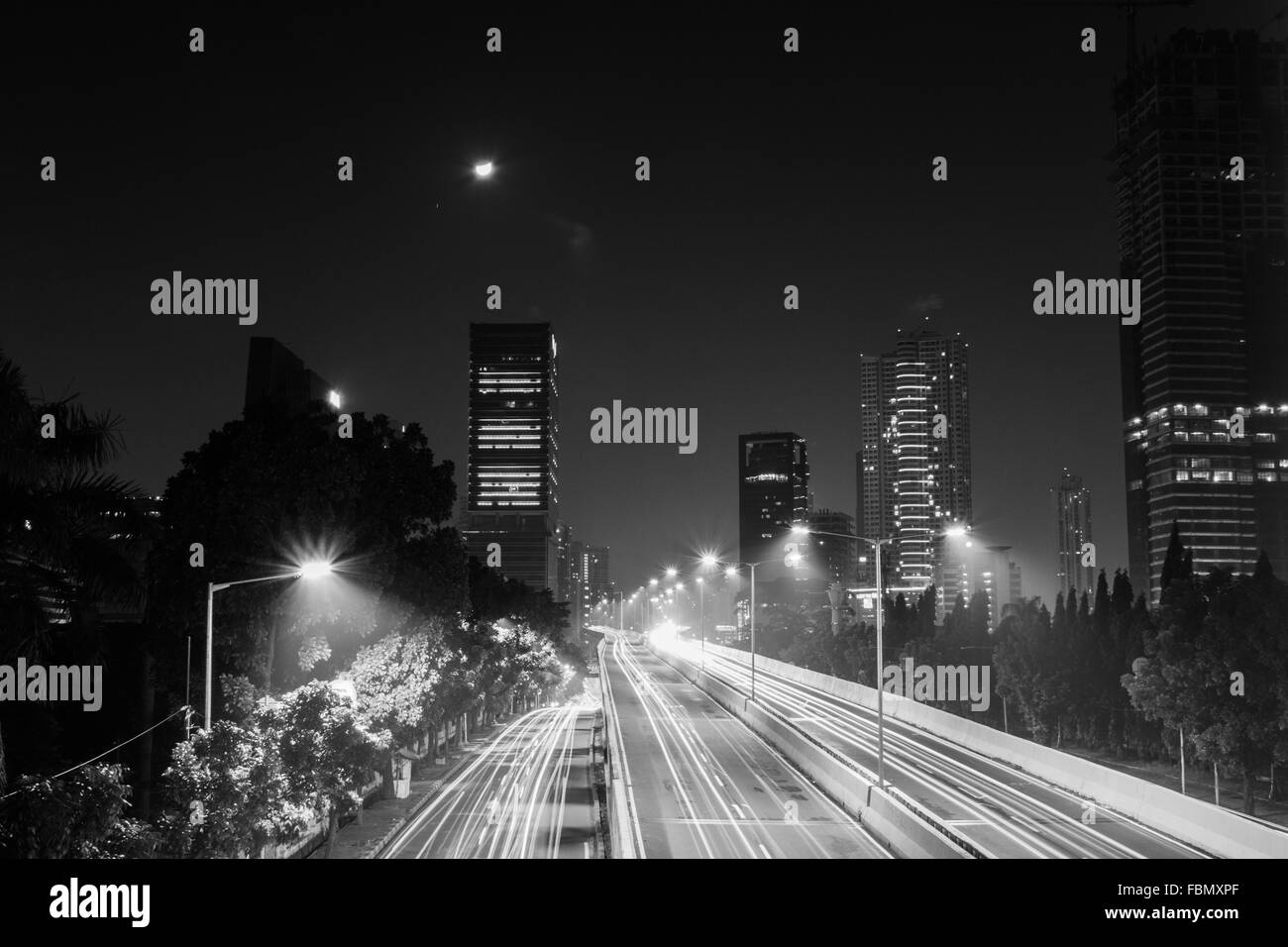 High Angle View Of Light Trails On Road At Night - Stock Image
