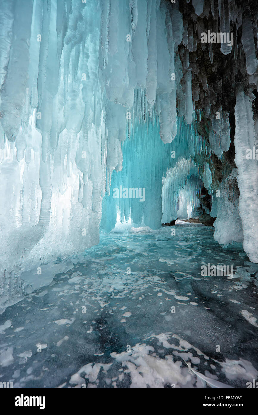 Ice cave on Olkhon island on Baikal lake in Siberia at winter time - Stock Image