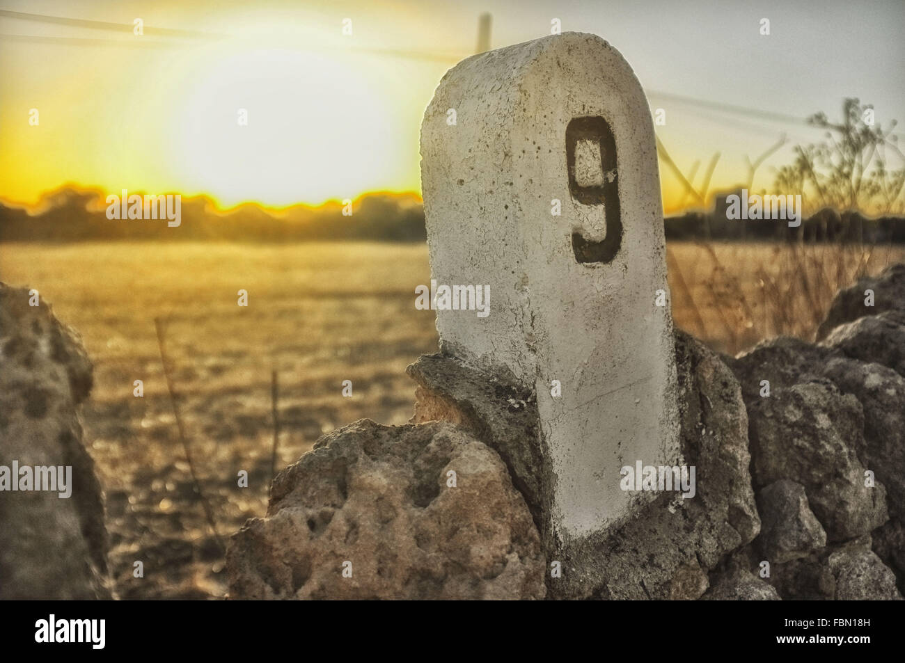 Distance Marker Against Sky During Sunset - Stock Image