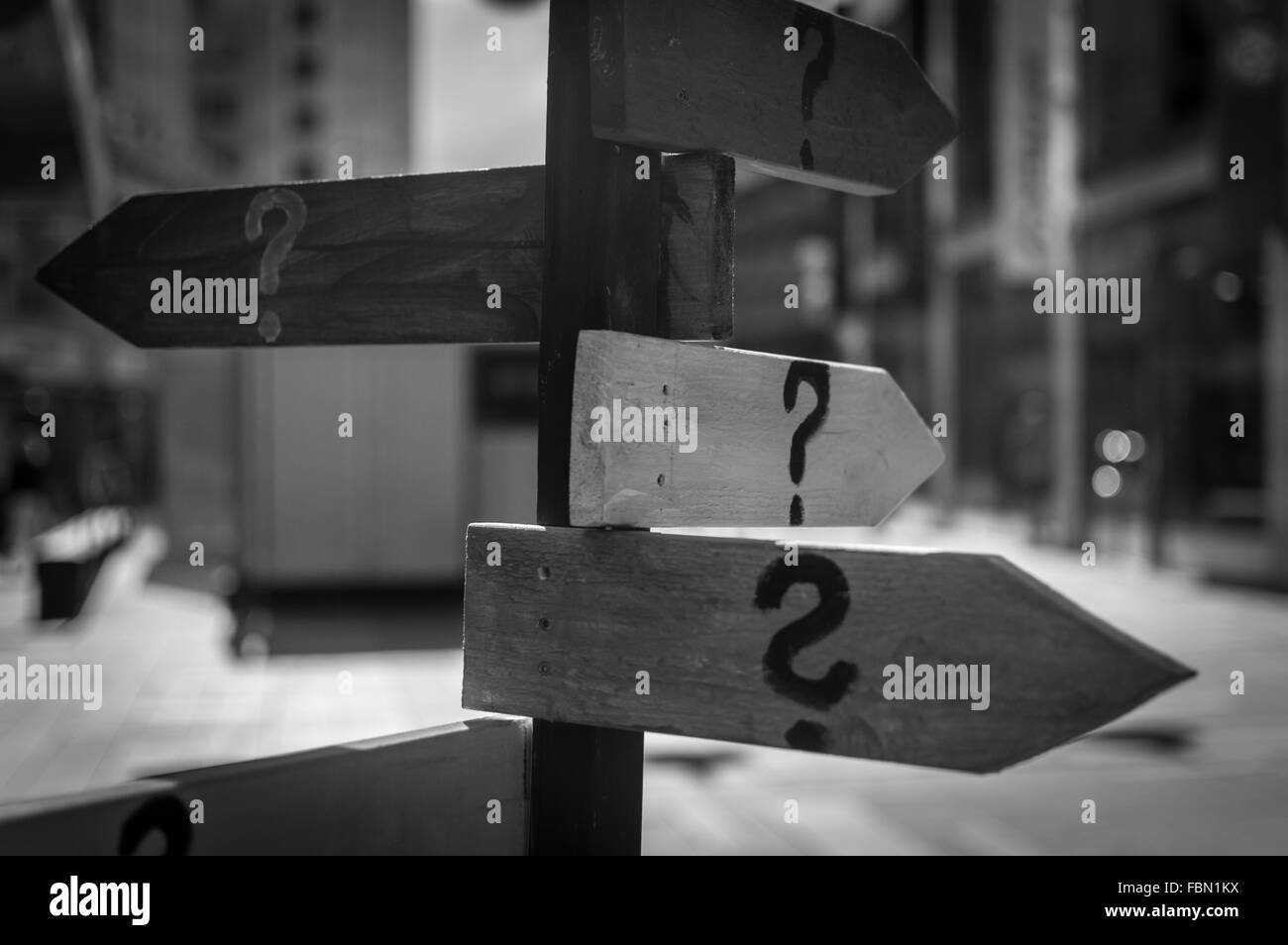 Close-Up Of Question Mark On Directional Signs On Street - Stock Image