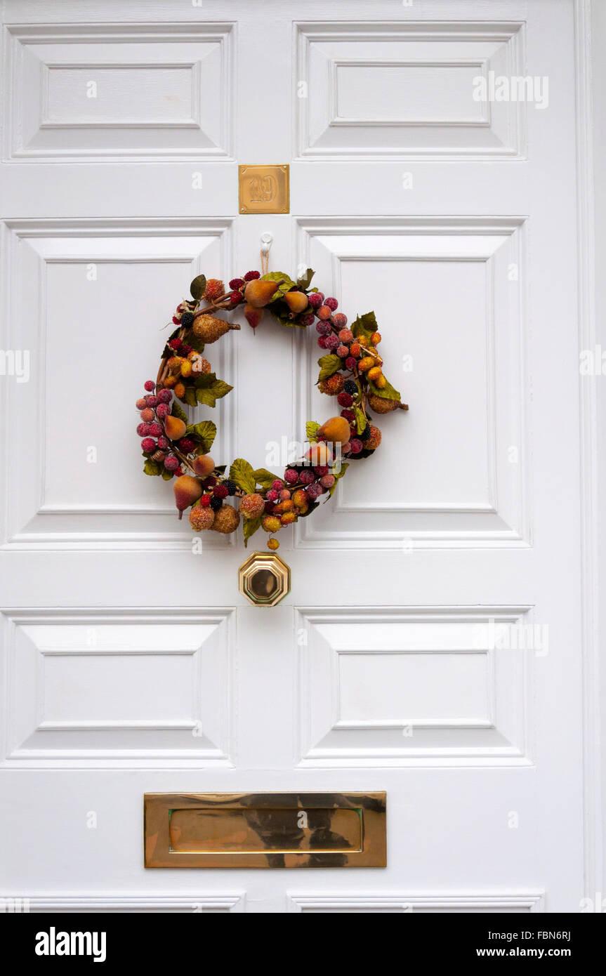 christmas wreath on front door hanging stock image - Simple Christmas Wreaths
