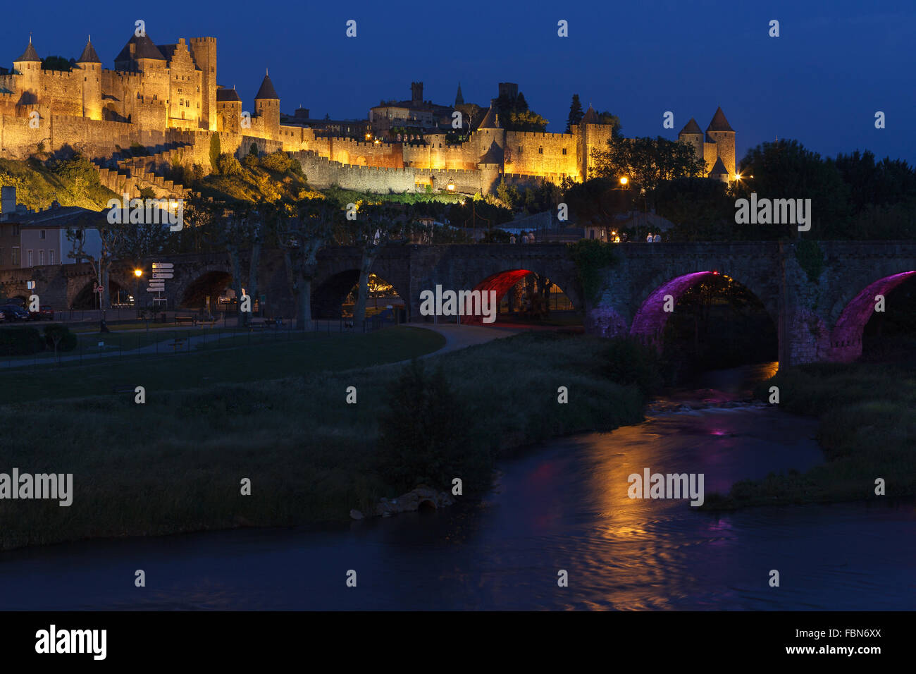 The fortified Cite de Carcassonne by the Aude River at night, Aude department, Languedoc-Roussillon region, France, - Stock Image