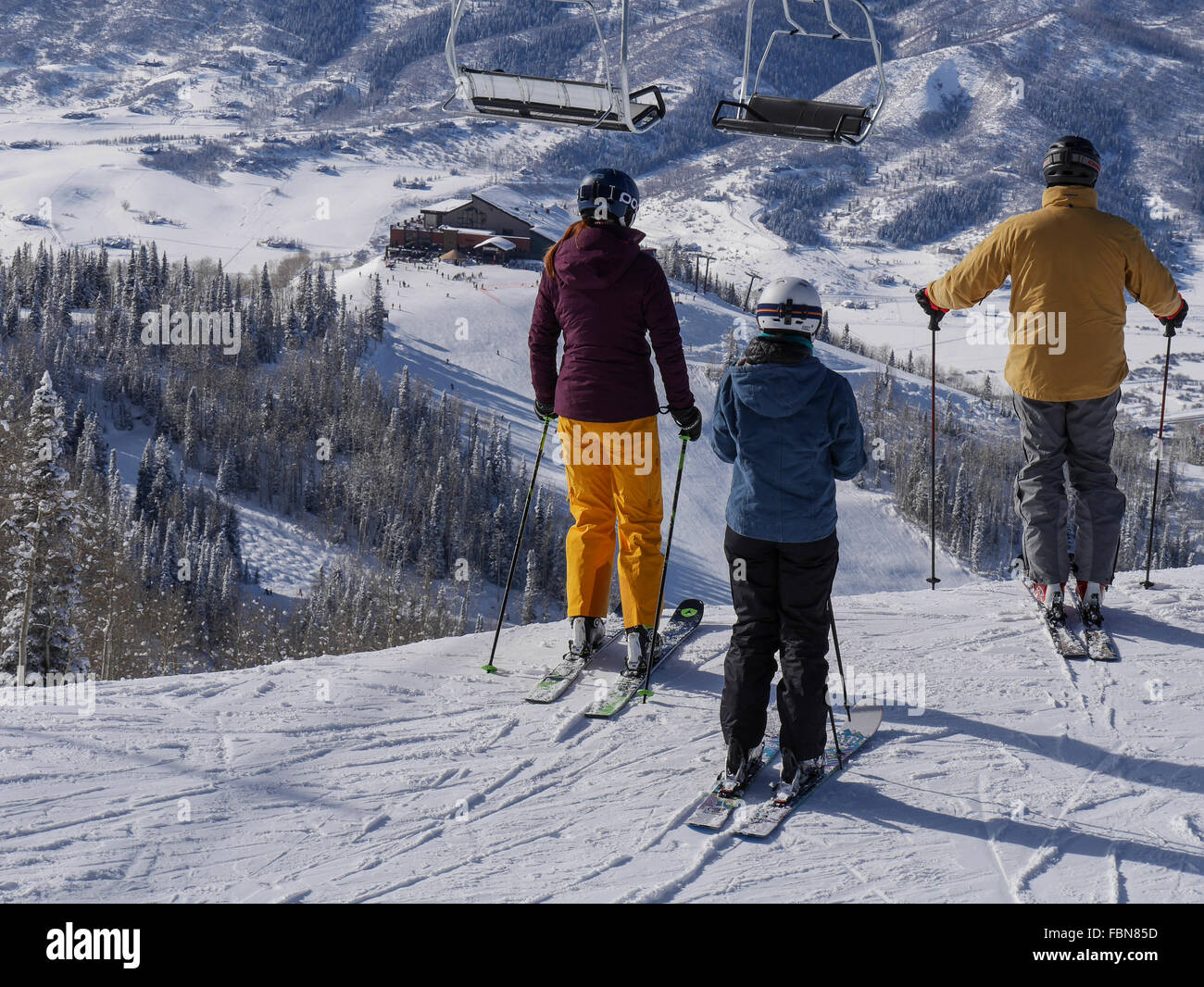 Skiers overlooking Thunderhead Lodge from Four Points Lodge, Steamboat Ski Resort, Steamboat Springs, Colorado. - Stock Image