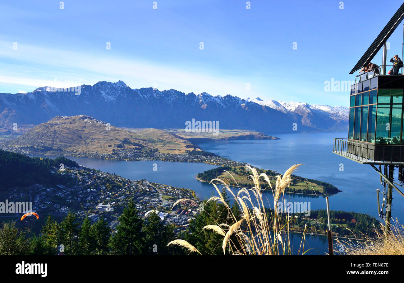 People over looking Queenstown from The Skyline  look-out  at the top of the gondola Queenstown, South Island, New - Stock Image