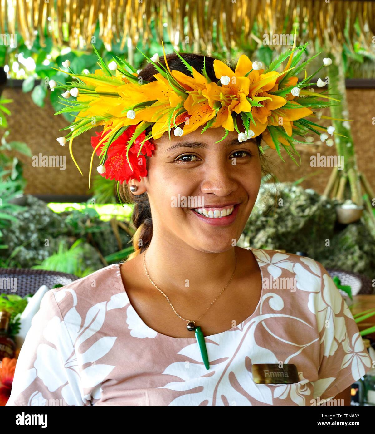 Cook Islander bar- lady wearing   headband garland at the Pacific Resort Aitutaki .Aitutaki Cook Islands South Pacific - Stock Image