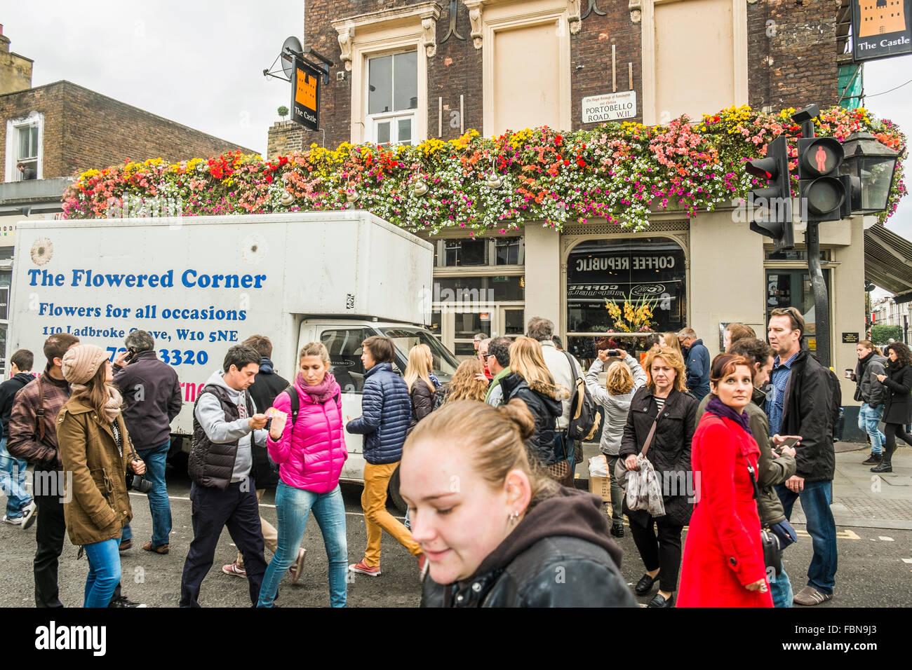 visitors of portobello street market in front of the pub the castle, 225 portobello road, notting hill, london, - Stock Image