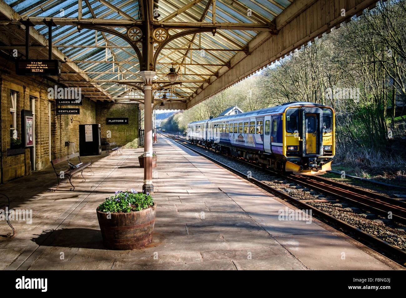 Northern Rail train pulling into Hebden Bridge station, West Yorkshire, England. - Stock Image