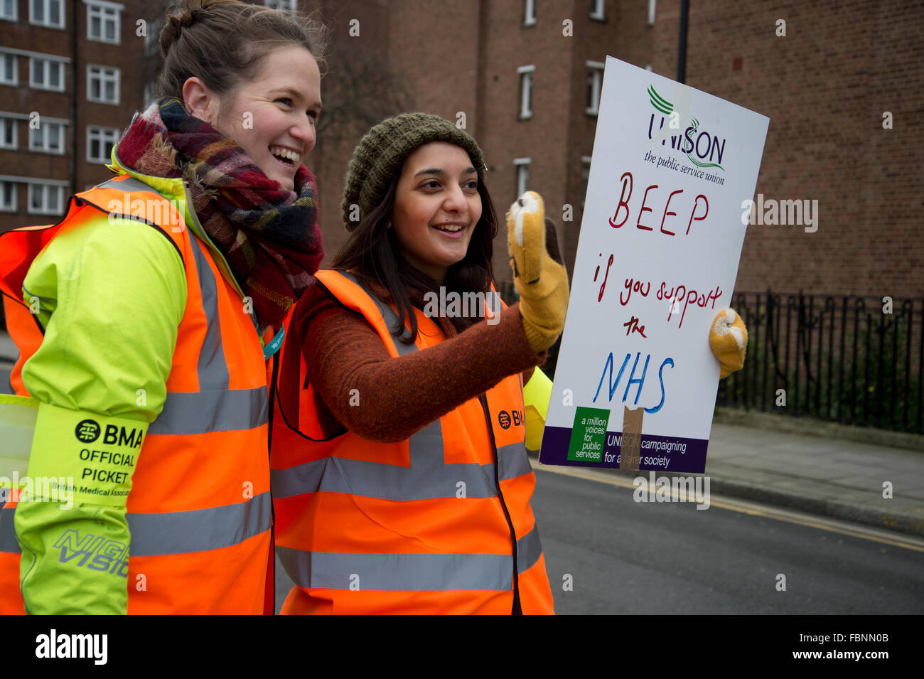 Homerton hospital, Hackney, London. Junior doctors on strike for 24 hours, asking motorists to beep in support. - Stock Image