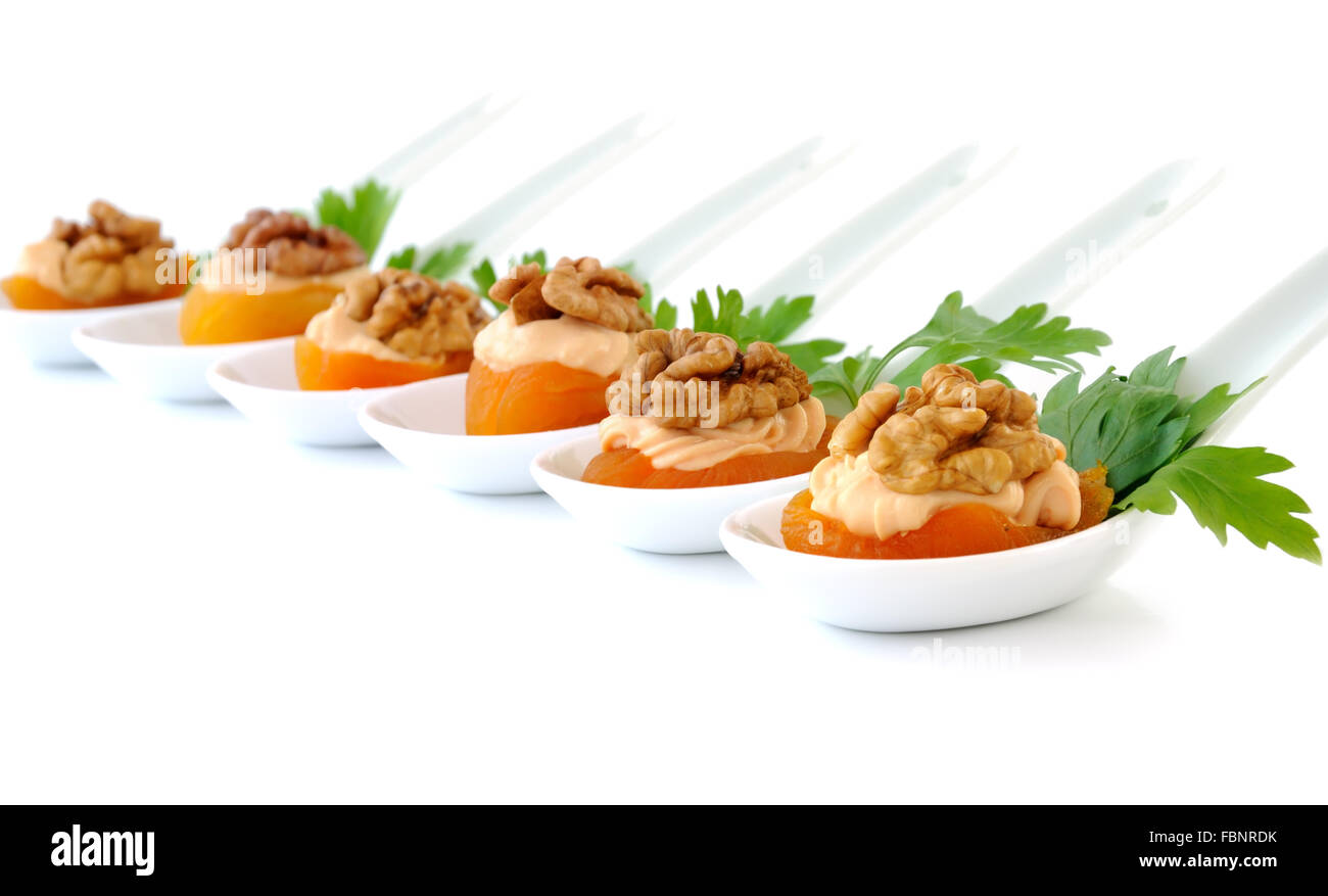 Apricot Stuffed creamy apricot stuffing with nuts isolated - Stock Image