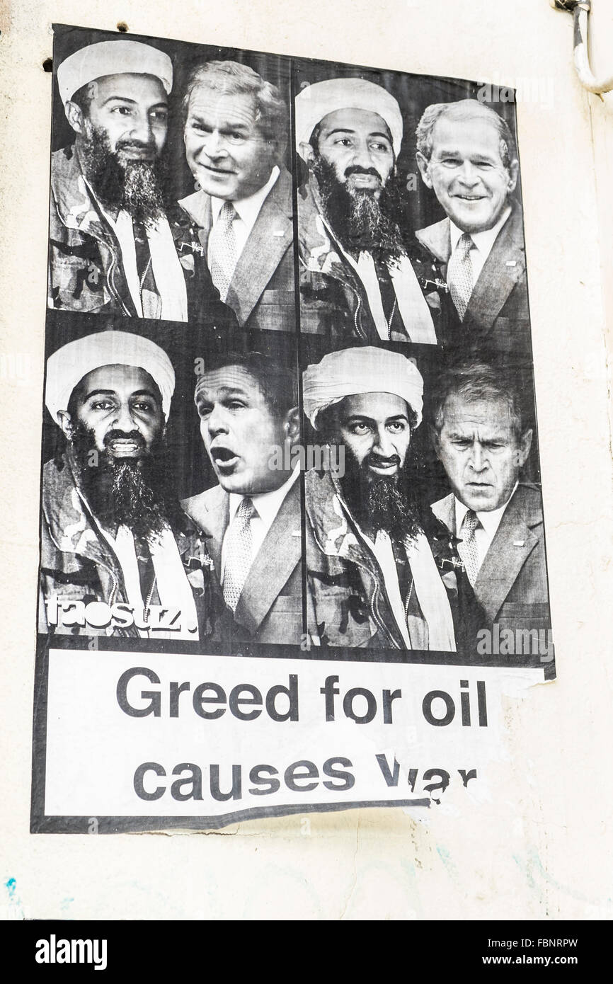 poster showing george w. bush and osama bin laden an a text that reads: greed for oil causes war, london, england - Stock Image