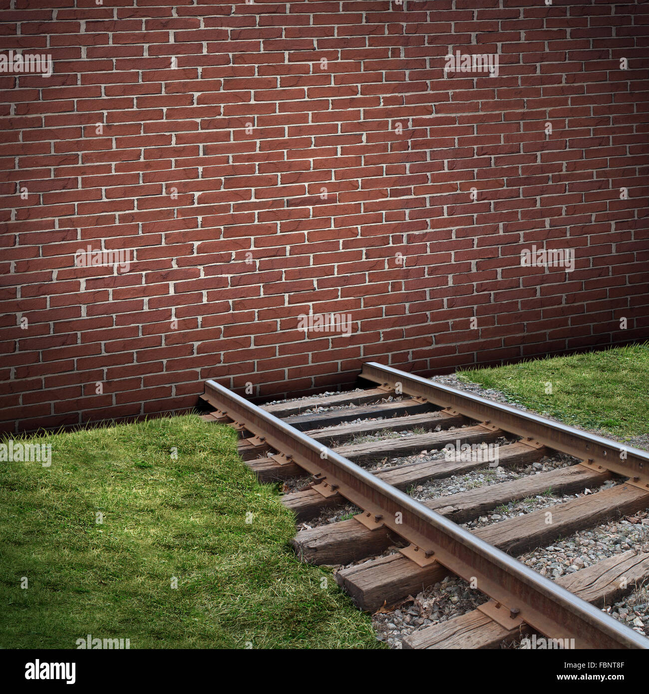 Road block or roadblock concept as a closed brick wall barricade blocking a train track as a business or life  closed - Stock Image