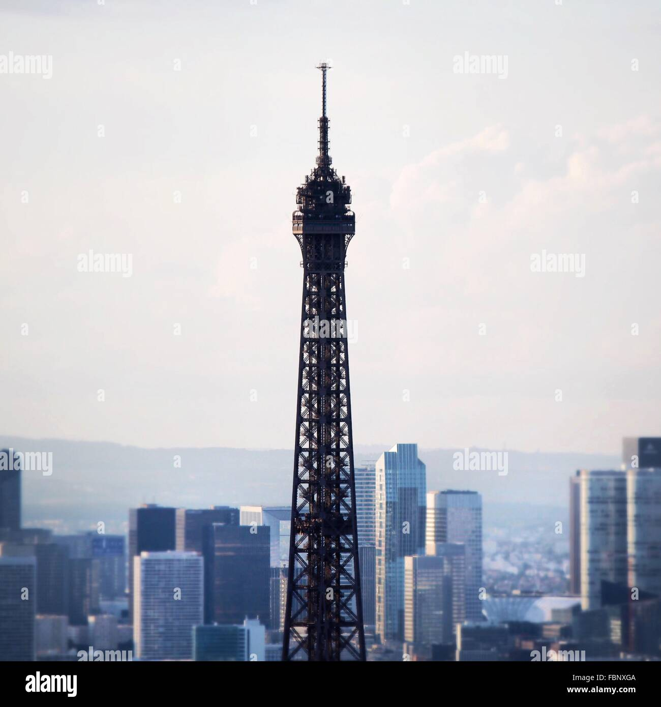 High Section Of Eiffel Tower Against Buildings In City - Stock Image