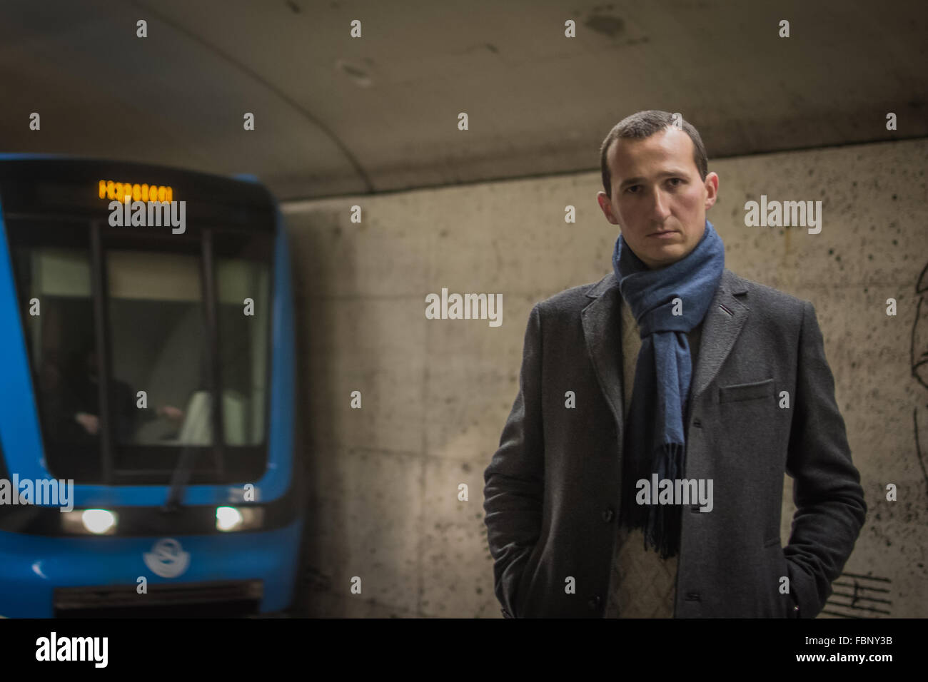 Portrait Of Man Standing On Railroad Platform - Stock Image