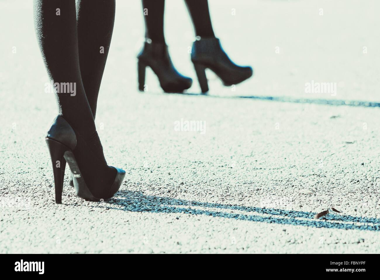 Low Section Of Women With High Heels On Street - Stock Image