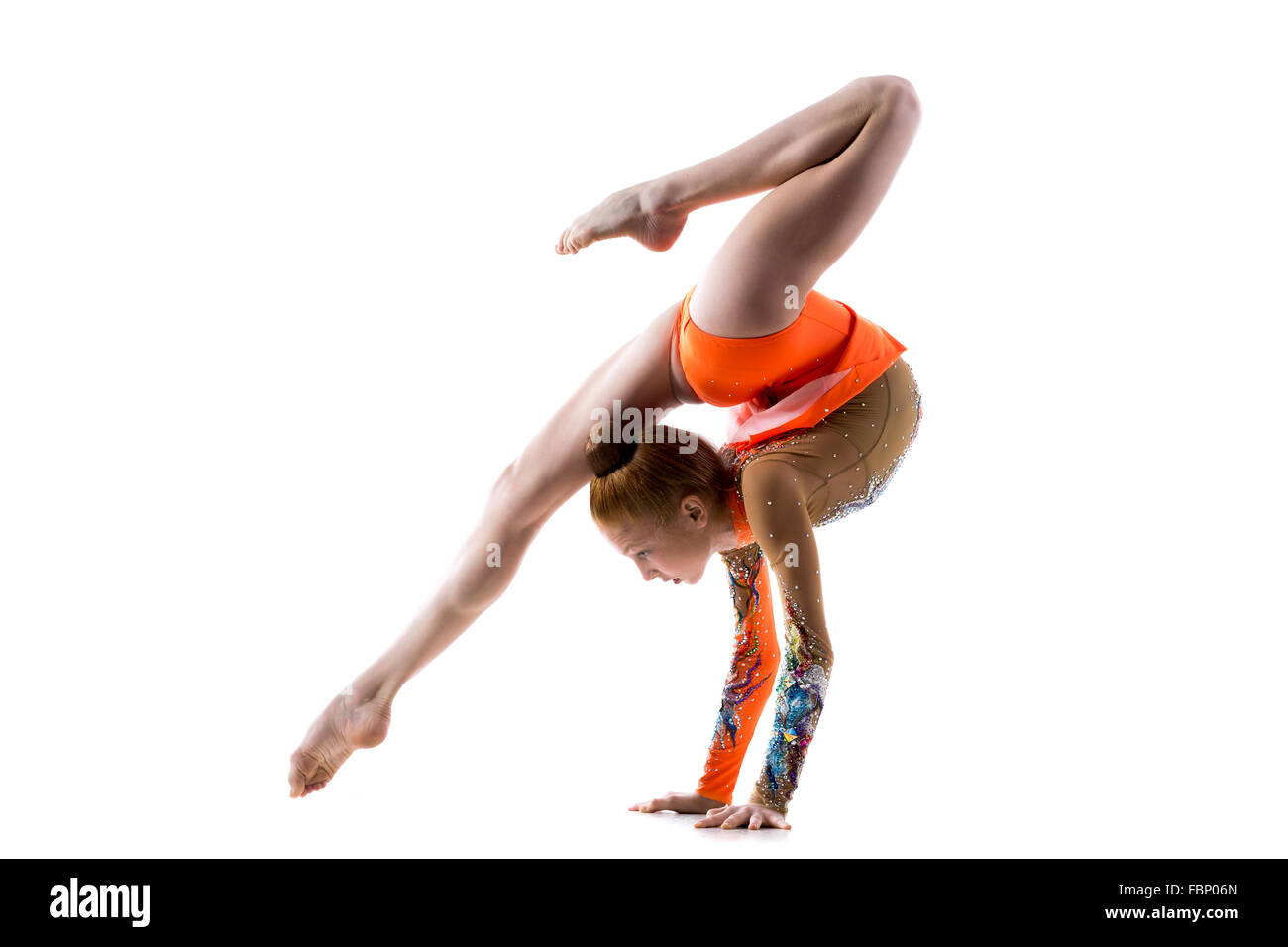 Beautiful gymnast athlete teenage girl wearing dancer colorful leotard working out, dancing, doing backbend, handstand - Stock Image