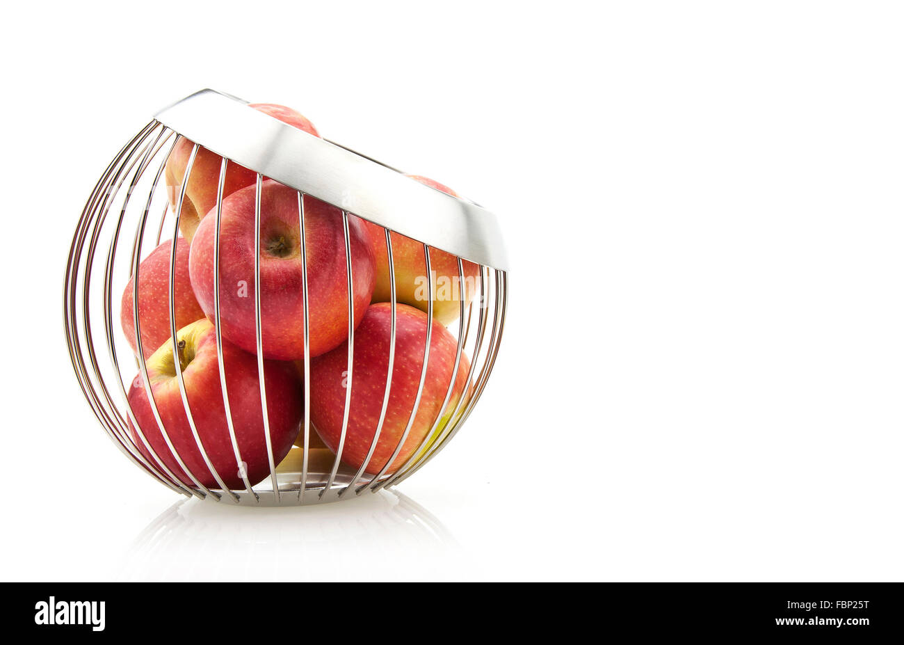 Fresh ripe red apples in Stainless Steel bowl on white background. - Stock Image
