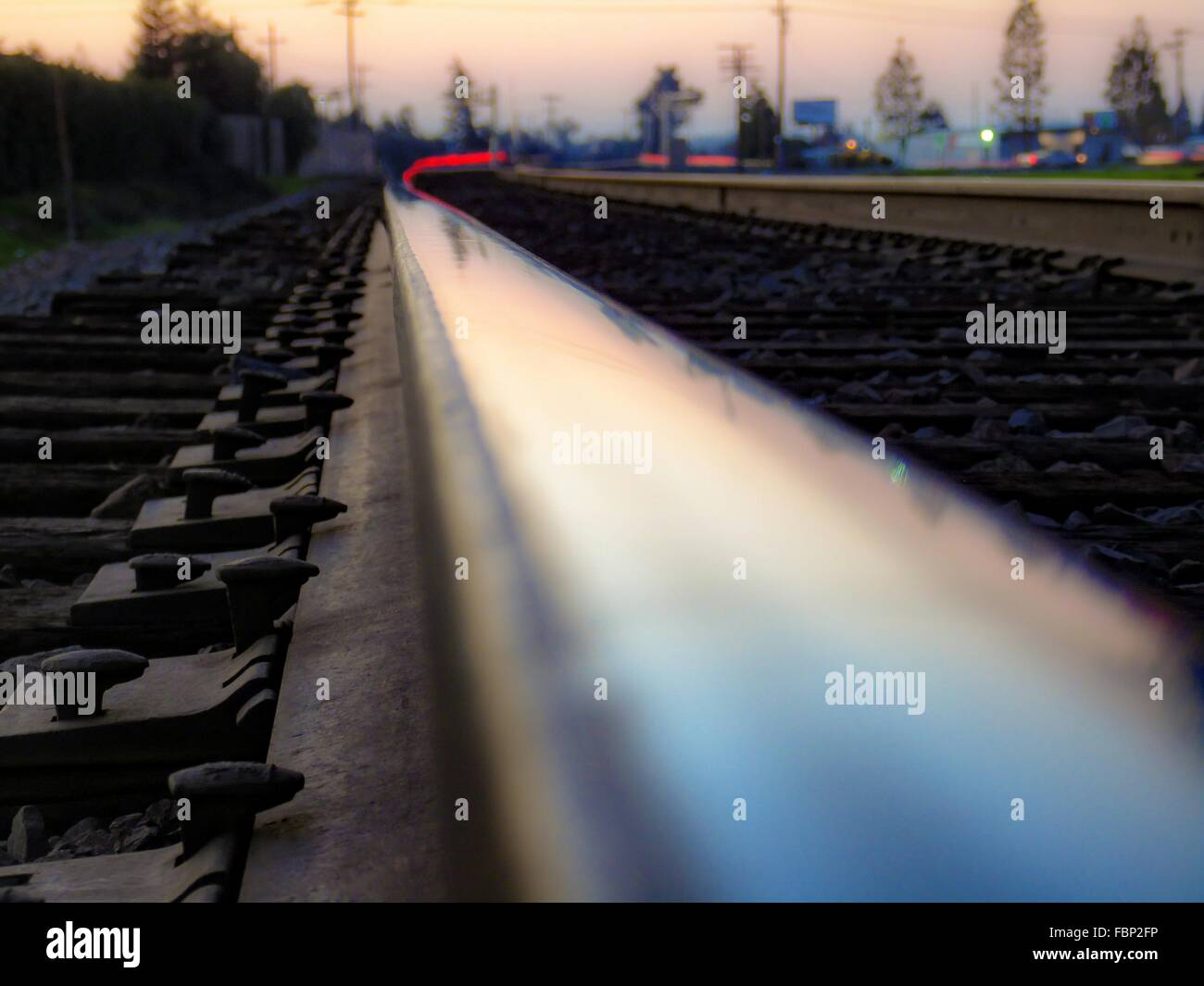 Surface Level Of Railway Track At Dusk - Stock Image
