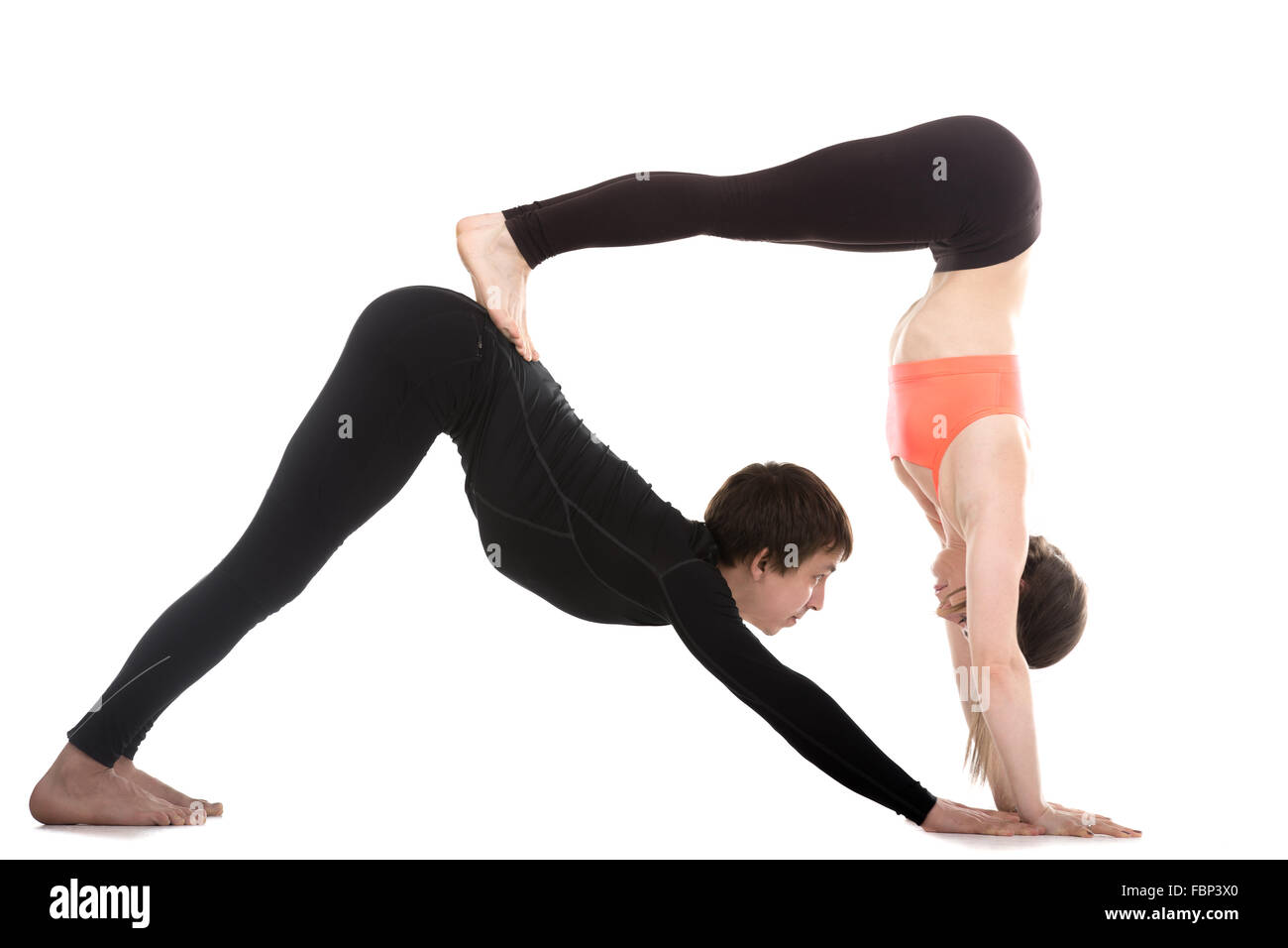 Sporty Couple On White Background Doing Acroyoga Yoga With Partner Double Downward Facing Dog Pose Adho Mukha Svanasana