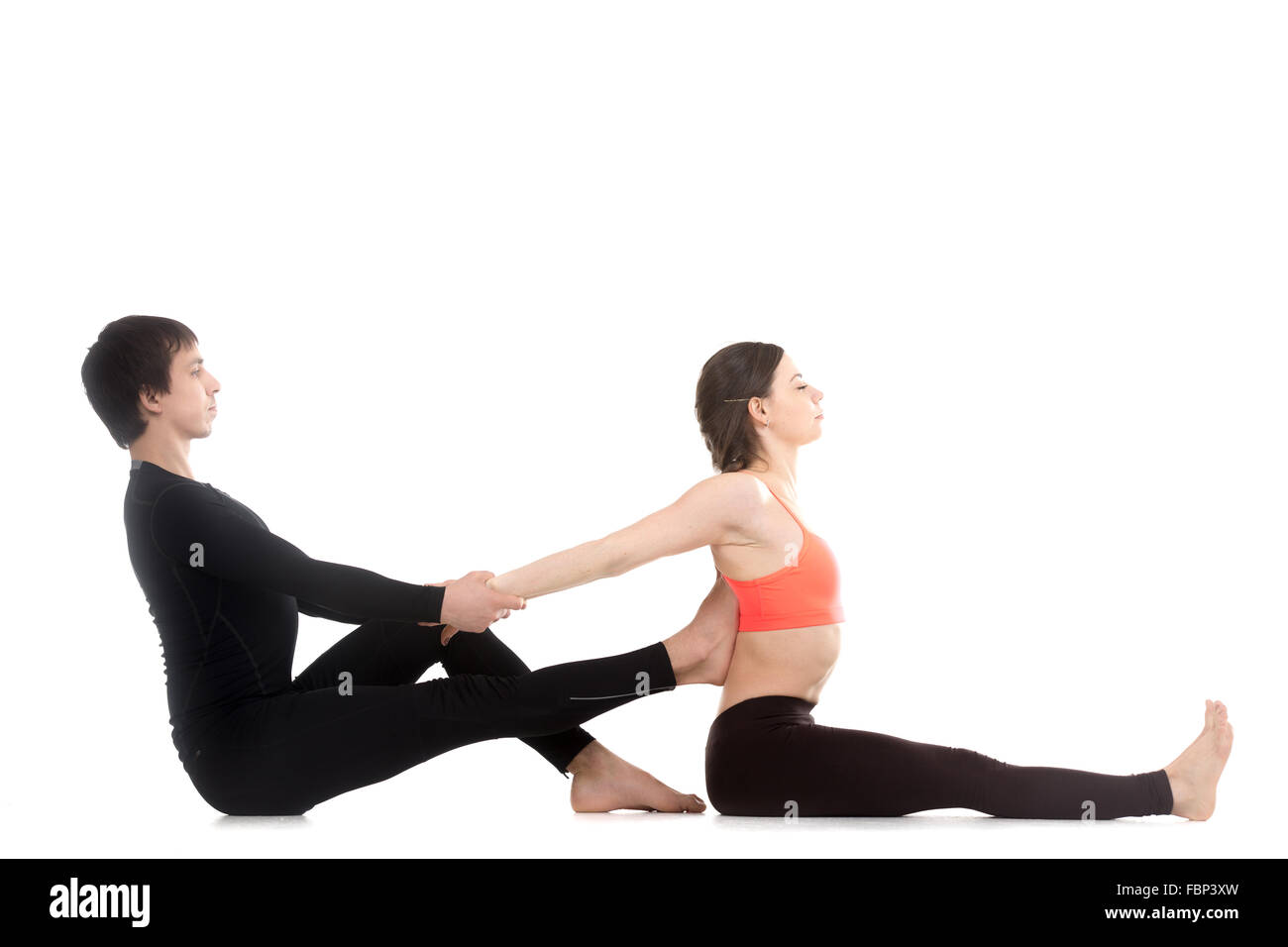 Two Sporty People Practicing Yoga Young Man Helping His Female Stock Photo Alamy