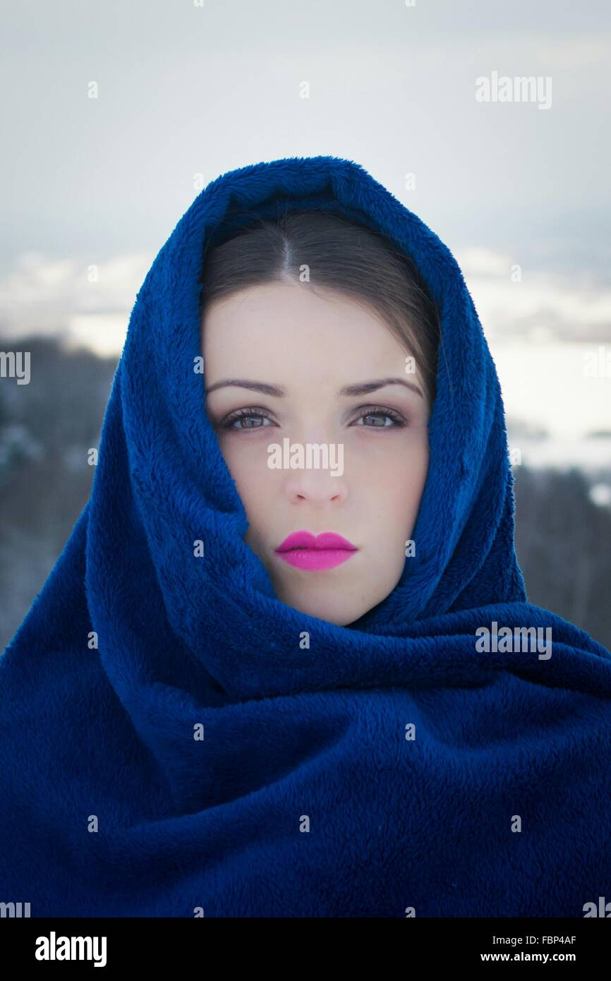 Portrait Of Beautiful Woman Covered With Head Scarf Outdoors Stock Photo