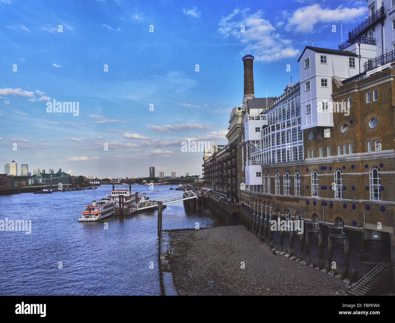 Riverfront Houses And Passenger Ship - Stock Image