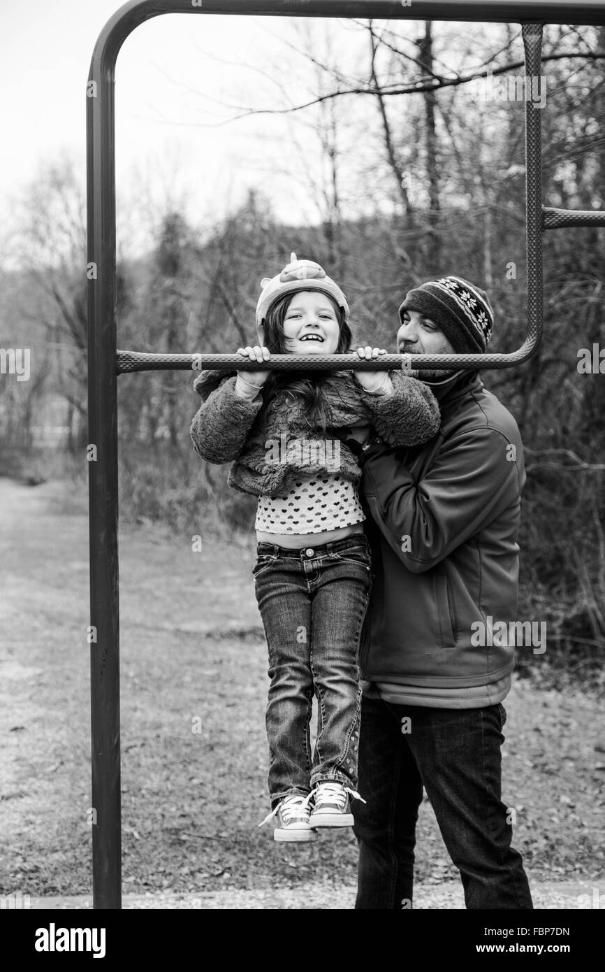 Father And Daughter Playing In Park - Stock Image