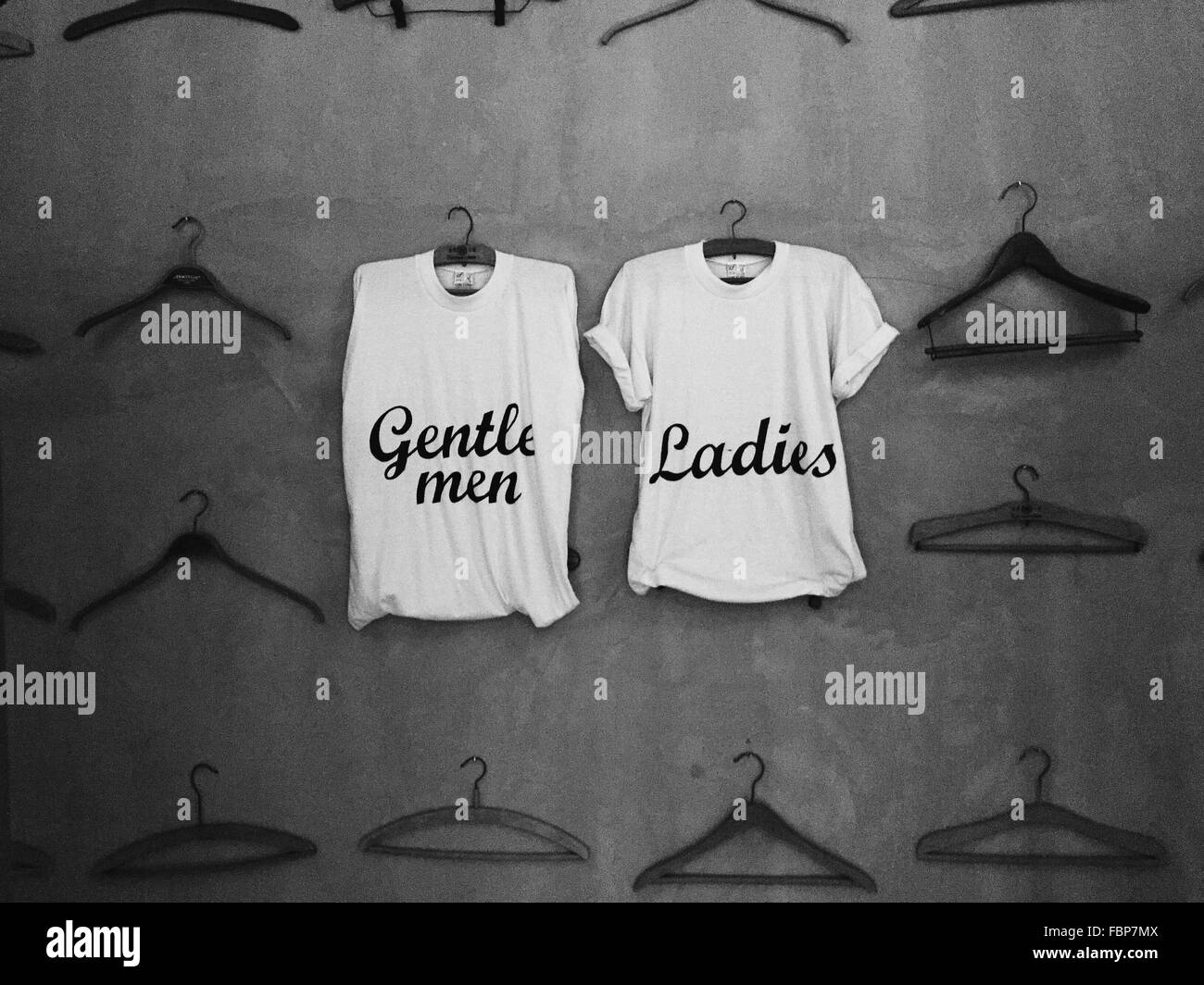Sleeveless Short And T-Shirt With 'Gentlemen' And 'Ladies' Inscription Respectively - Stock Image