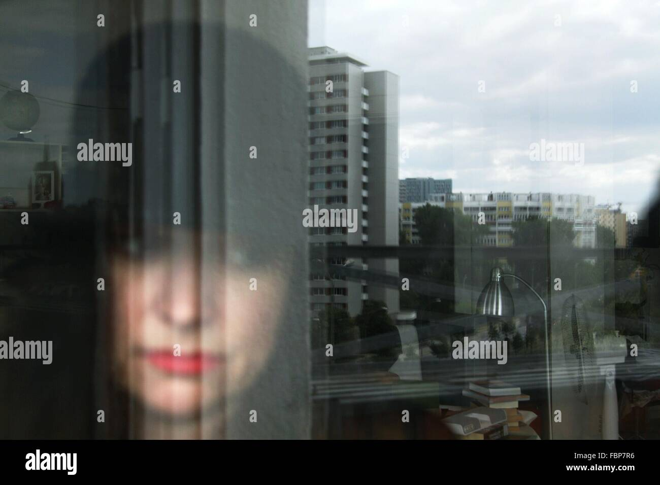 Reflection Of Young Woman On Glass Window Stock Photo
