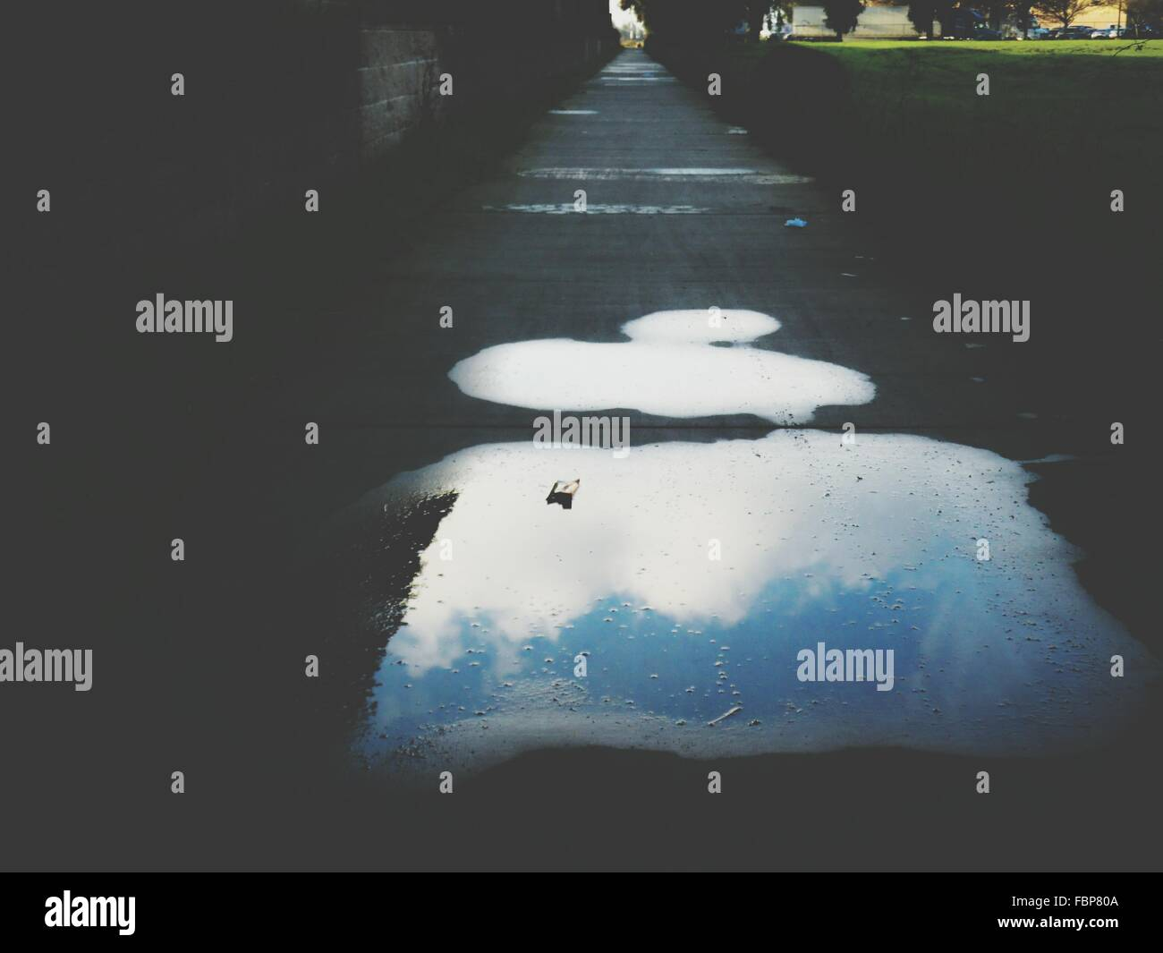 Reflection Of Clouds In Water At Narrow Pathway - Stock Image