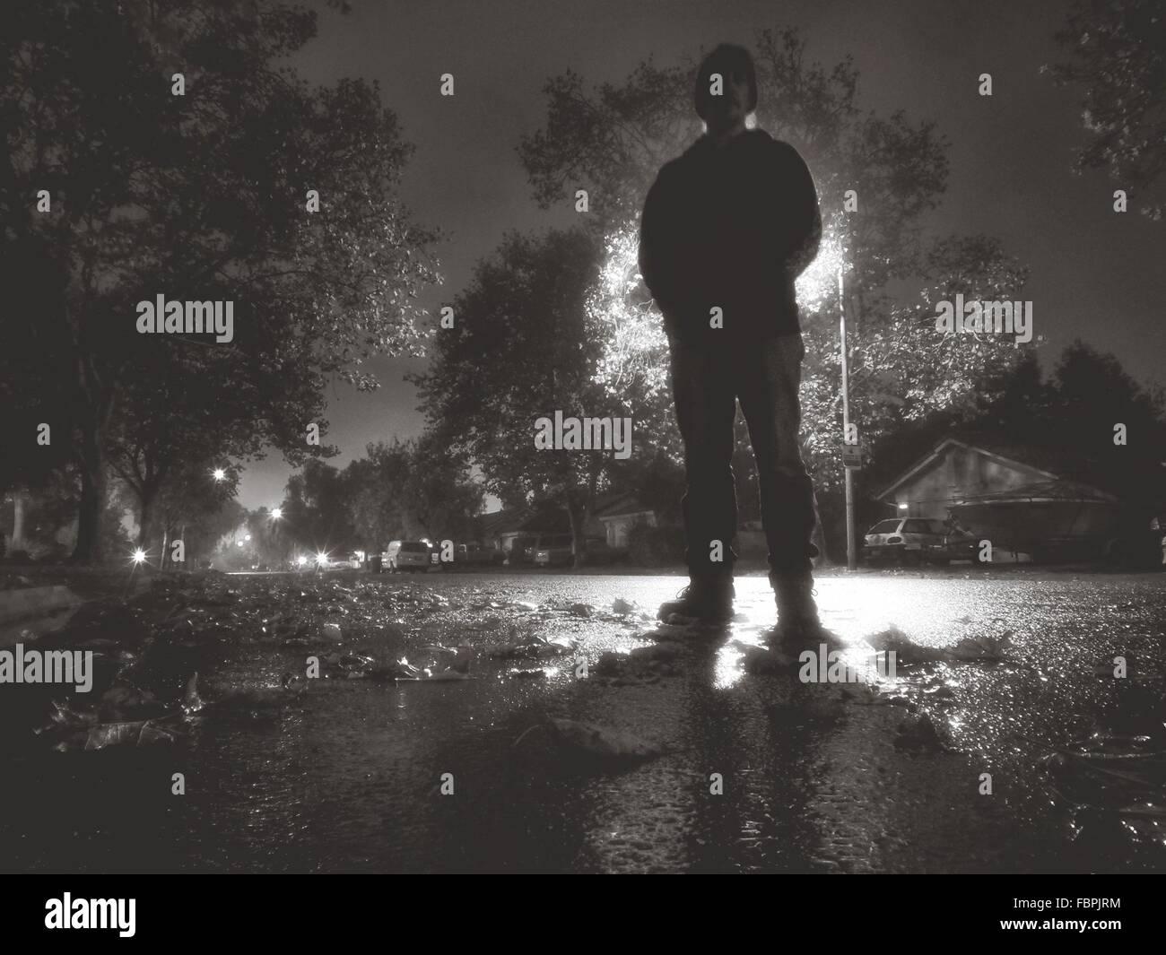 Full Length Of Man Standing On Street - Stock Image
