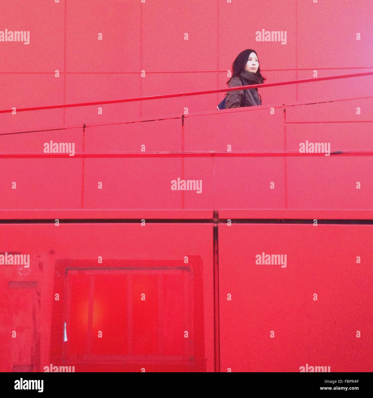 Woman On Red Stairway - Stock Image