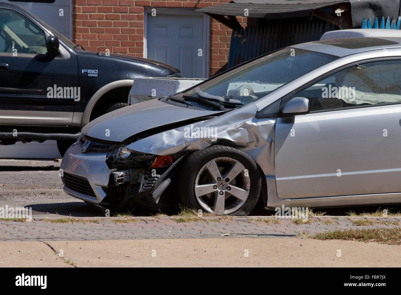 Car with front end accident damage - USA - Stock Image