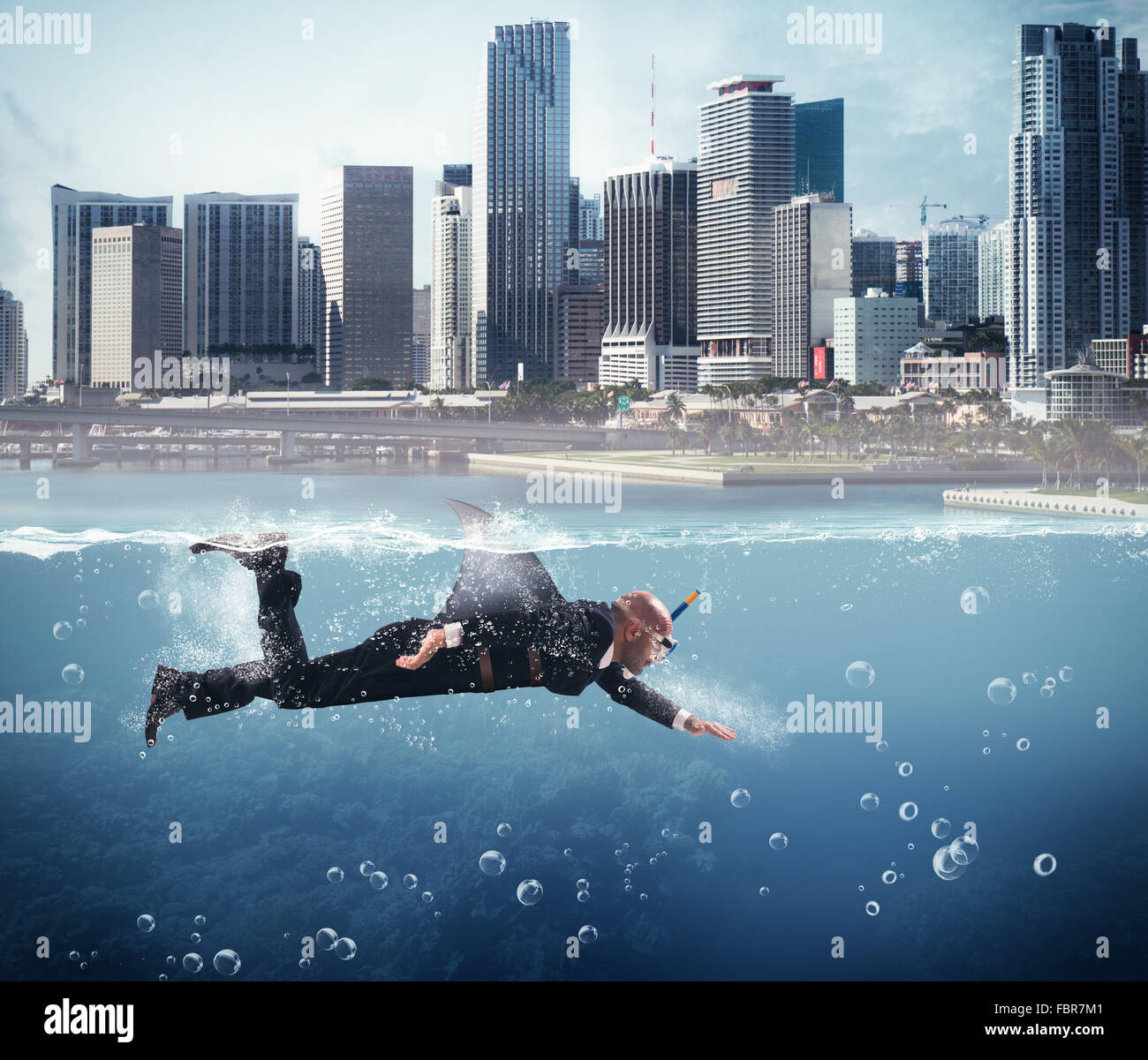 Businessman as shark - Stock Image