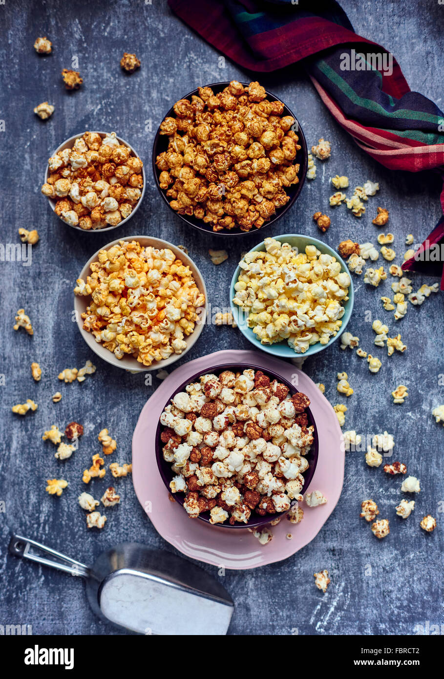 Five bows of various flavored popcorn - Stock Image