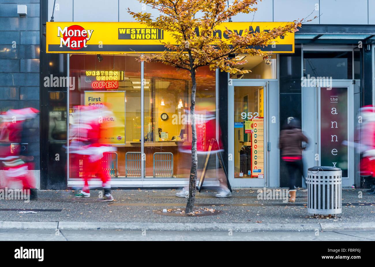 The Christmas rush, Hurrying Santas, Granville Street, Vancouver, British Columbia, Canada, - Stock Image