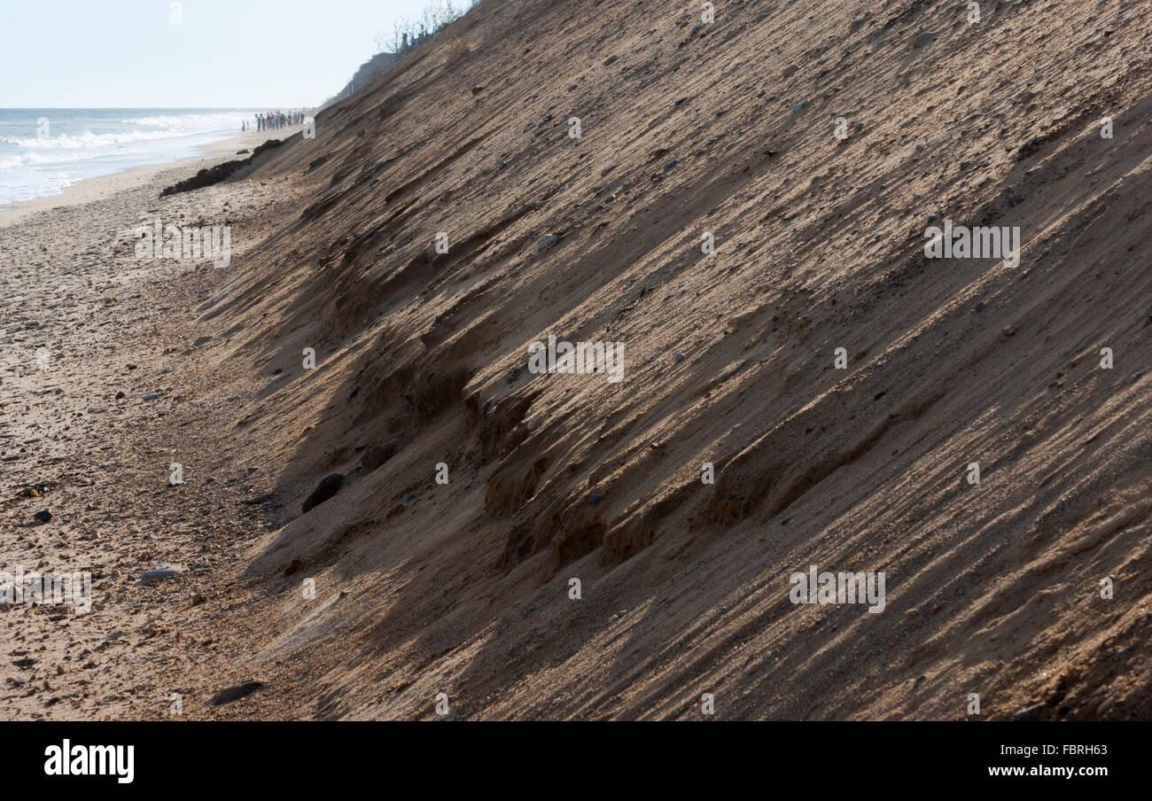 Coastal erosion wearing away sediments from a steep glacial scarp at Nauset Light Beach, Cape Cod National Seashore, - Stock Image
