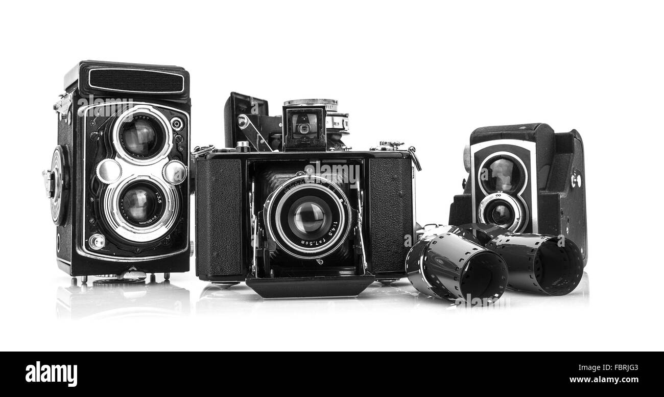 Old Film Cameras on white background - Stock Image