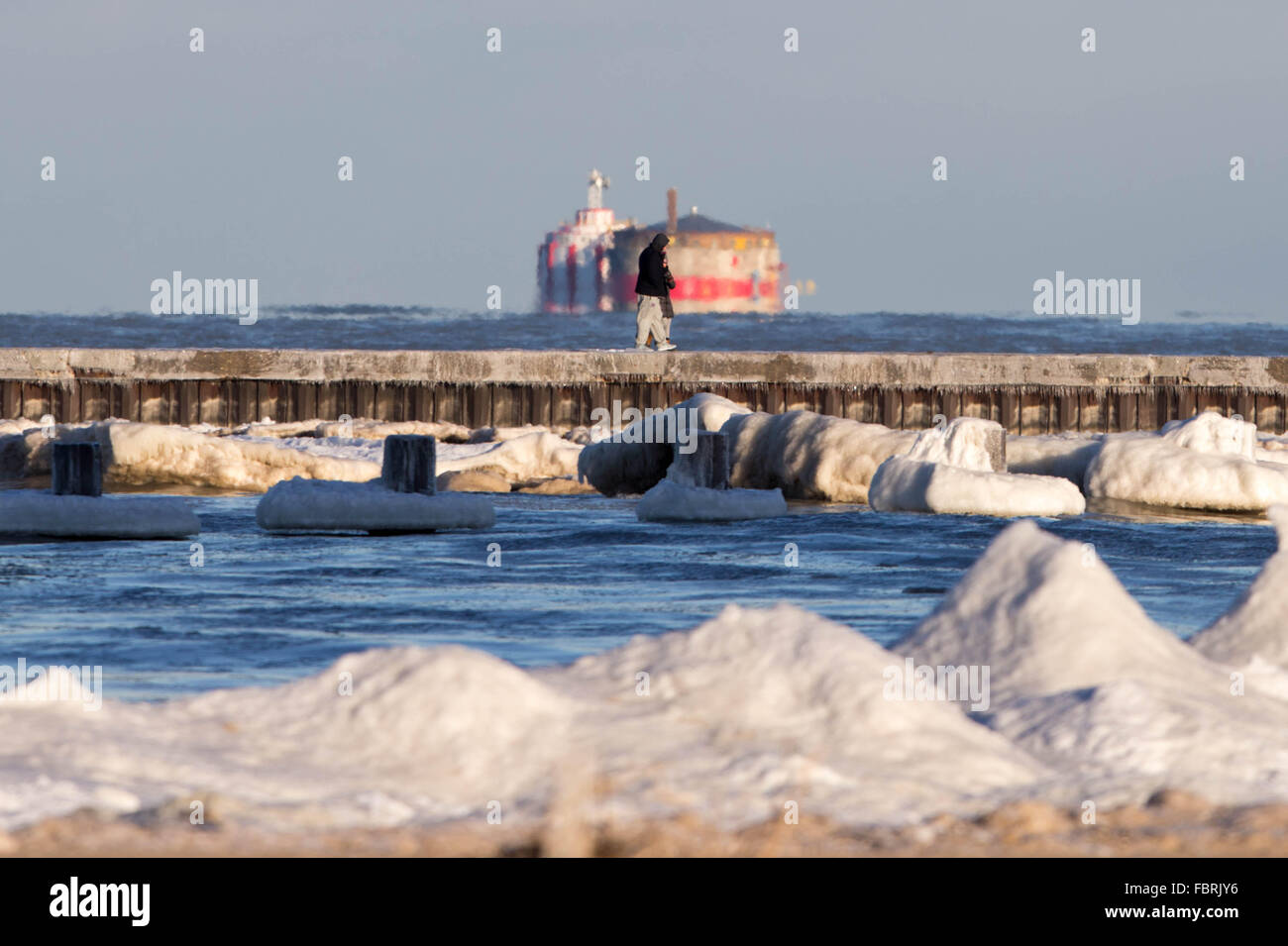 Chicago, USA. 19th Jan, 2016. People walk on the frozen bank of Lake Michigan as chilly weather continues in Chicago, - Stock Image