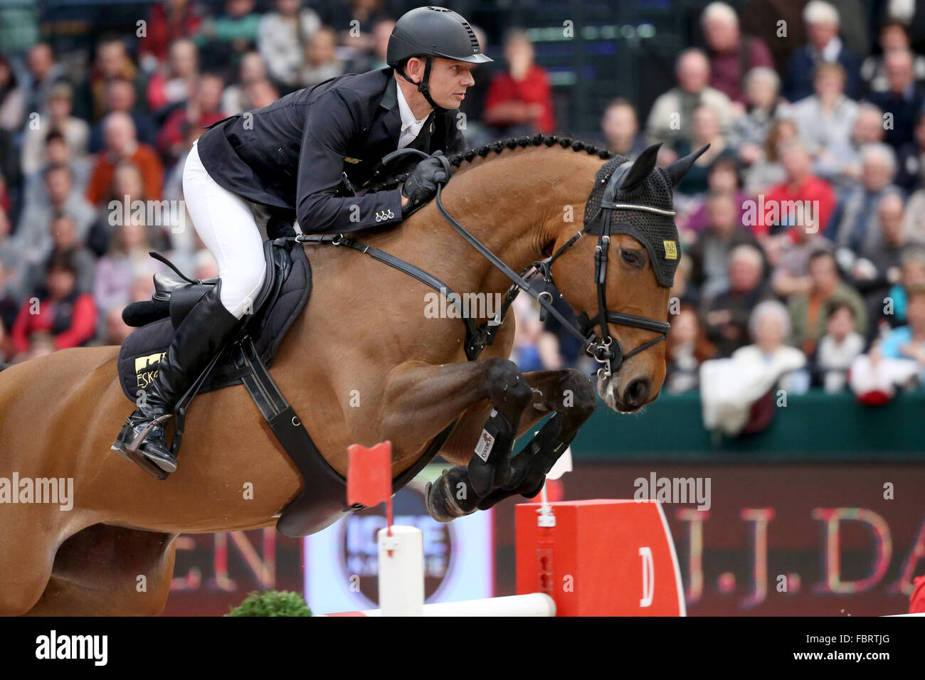 Leipzig, Germany. 17th Jan, 2016. Germany's Marco Kutscher riding Chaccorina jumps over a hurdle during the show Stock Photo